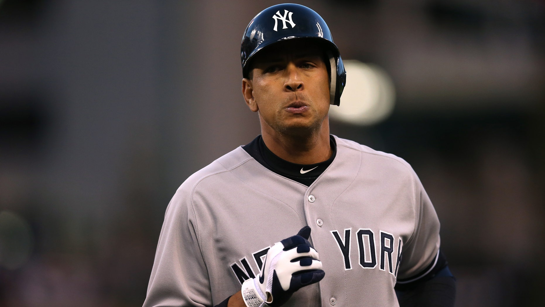 DETROIT, MI - OCTOBER 18:  Alex Rodriguez #13 of the New York Yankees reacts as he walsk back towards the dugout after he pinch hit and flied out in the top of the sixth inning against the Detroit Tigers during game four of the American League Championship Series at Comerica Park on October 18, 2012 in Detroit, Michigan.  (Photo by Jonathan Daniel/Getty Images)