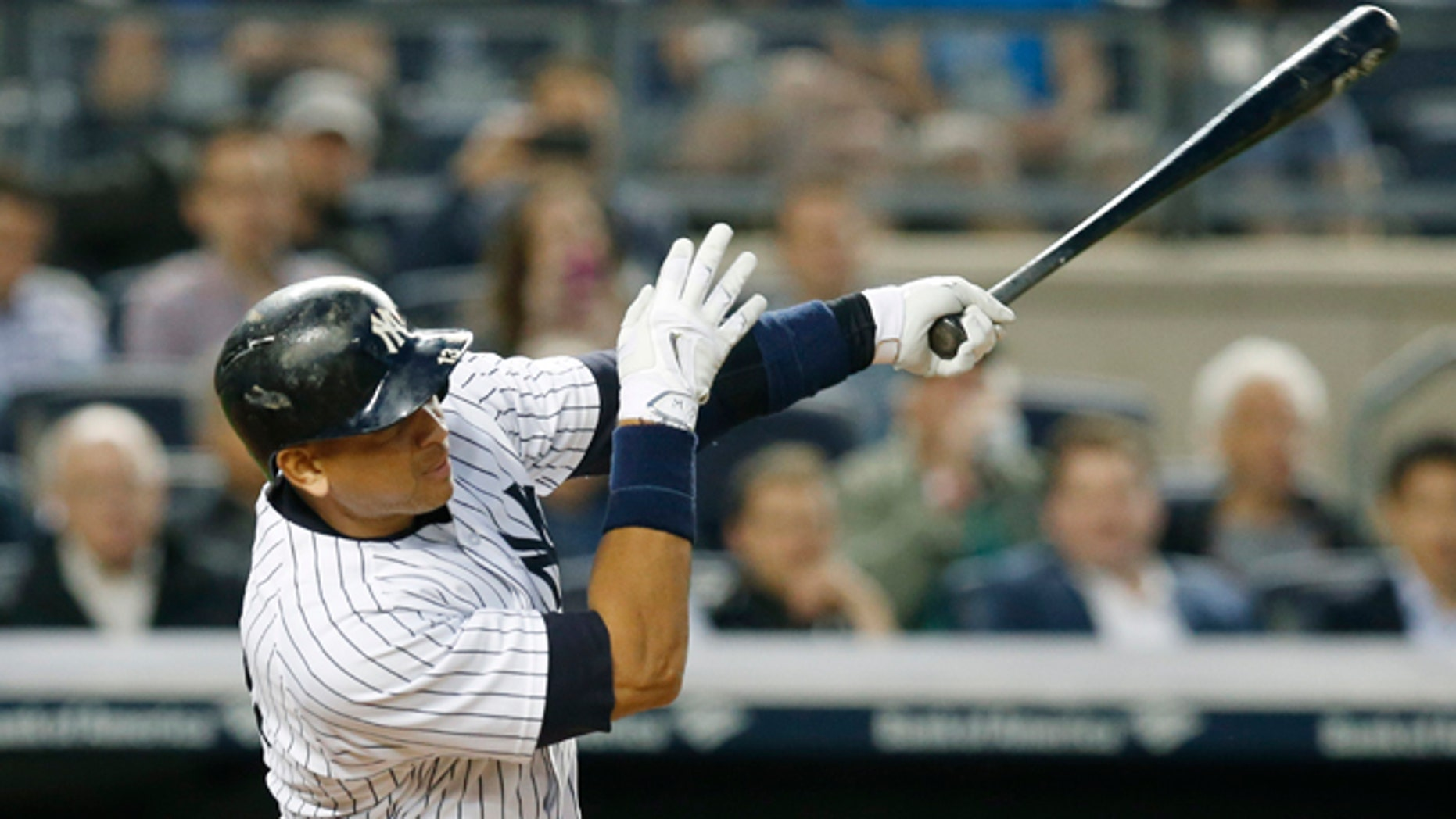 New York Yankees designated hitter Alex Rodriguez hits his 661st home run, surpassing Willie Mays for fourth on baseball's all-time home runs list, in a baseball game against the Baltimore Orioles at Yankee Stadium in New York, Thursday, May 7, 2015.  (AP Photo/Kathy Willens)