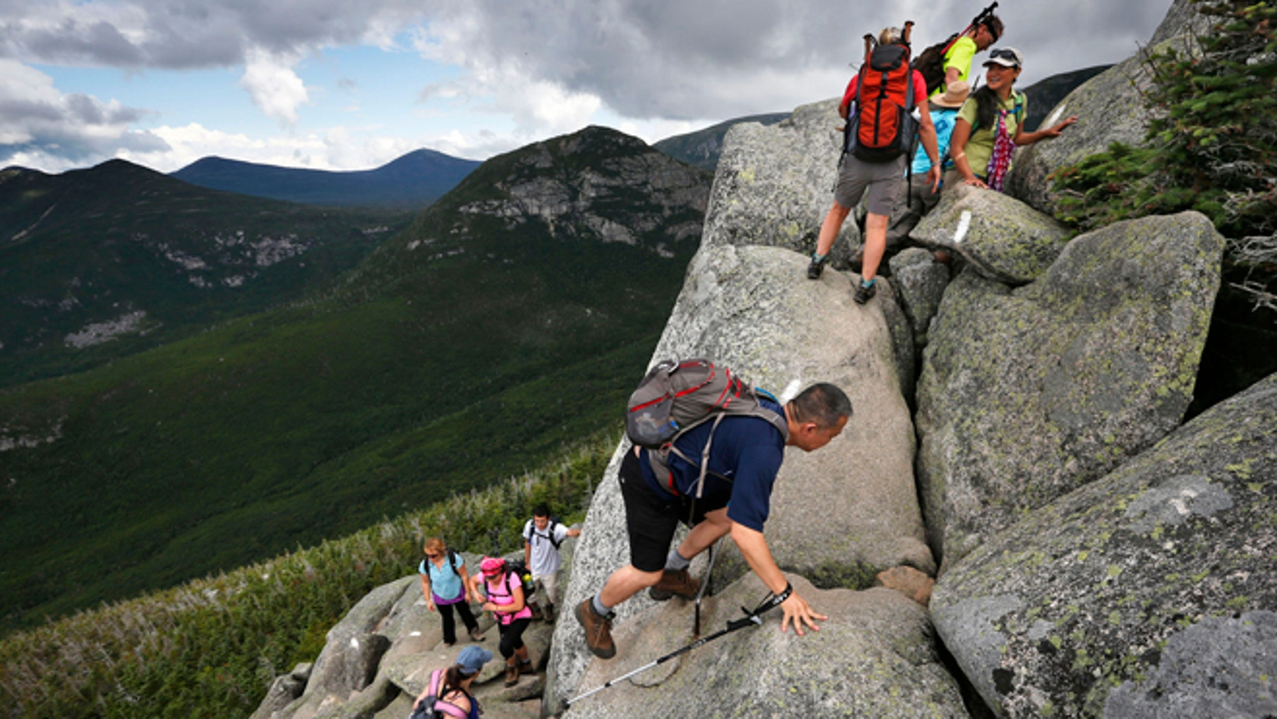 Aug. 7, 2015: Day-hikers scramble over rocky boulders on the Appalachian Trail below the summit of Mt. Katahdin in Baxter State Park in Maine. The sharp rise in the number people using the Appalachian Trail is causing headaches for officials, who say theyre dealing with increasing problems along the 2,189-mile footpath.
