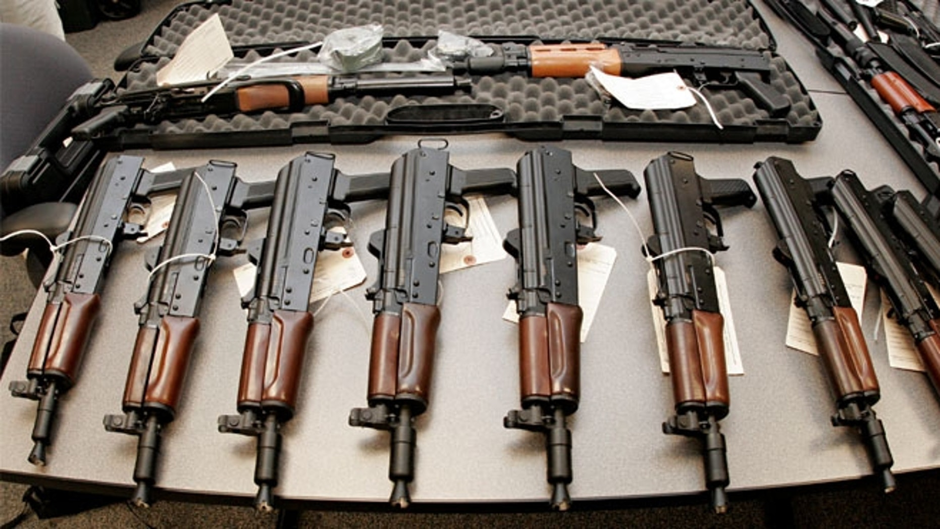 This 2008 file photo shows weapons seized by the Bureau of Alcohol, Tobacco, Firearms and Explosives (ATF), and laid out on a table at the bureau's Arizona headquarters in Phoenix.