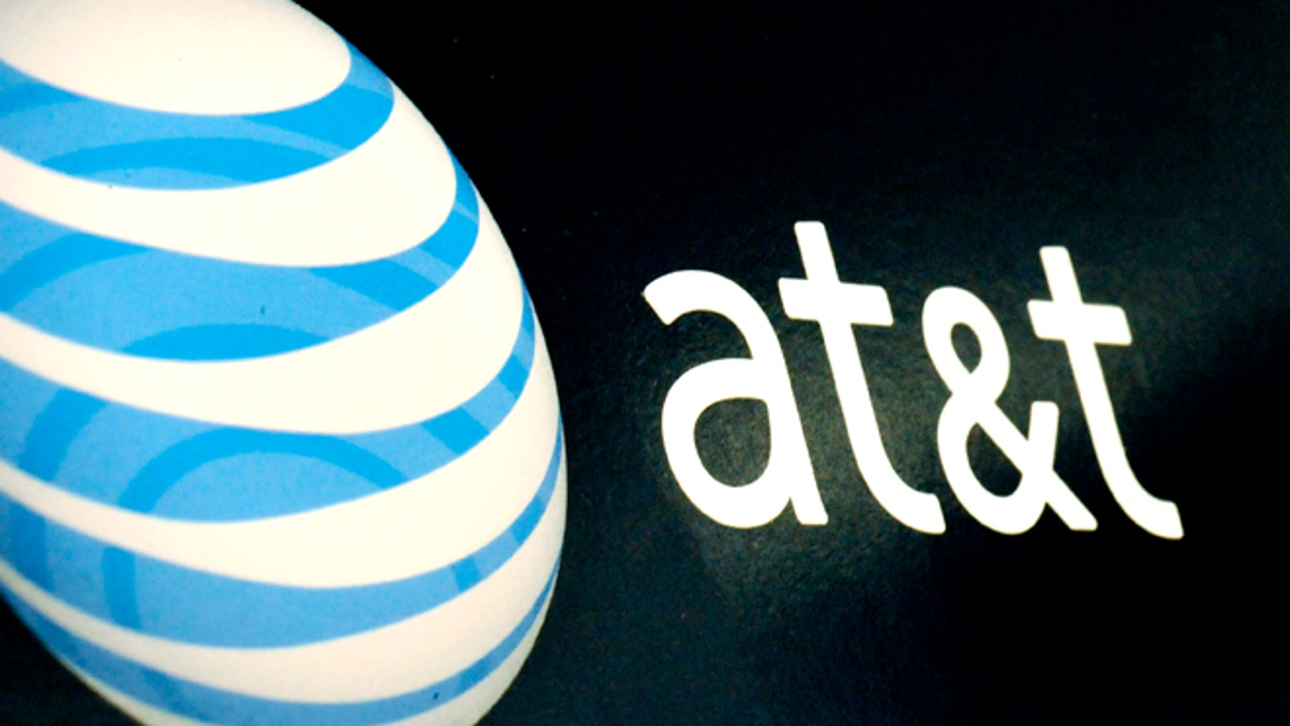 The AT&T logo is on display at a RadioShack store in Gloucester, Mass.