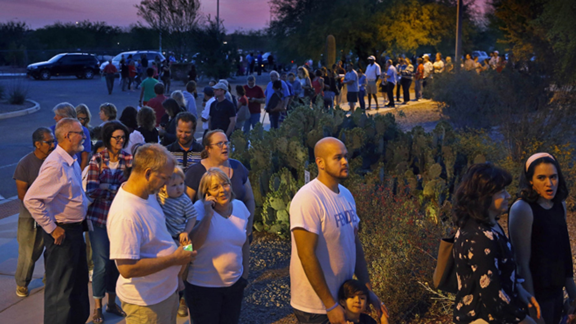 People wait in line to vote in the primary at the Environmental Education Center, Tuesday, March 22, 2016, in Chandler, Ariz. Residents in metro Phoenix have been bristling for years over a perception that state leaders want to make it harder for them to vote, and the mess at the polls Tuesday only heightened the frustration.  (David Kadlubowski/The Arizona Republic via AP)