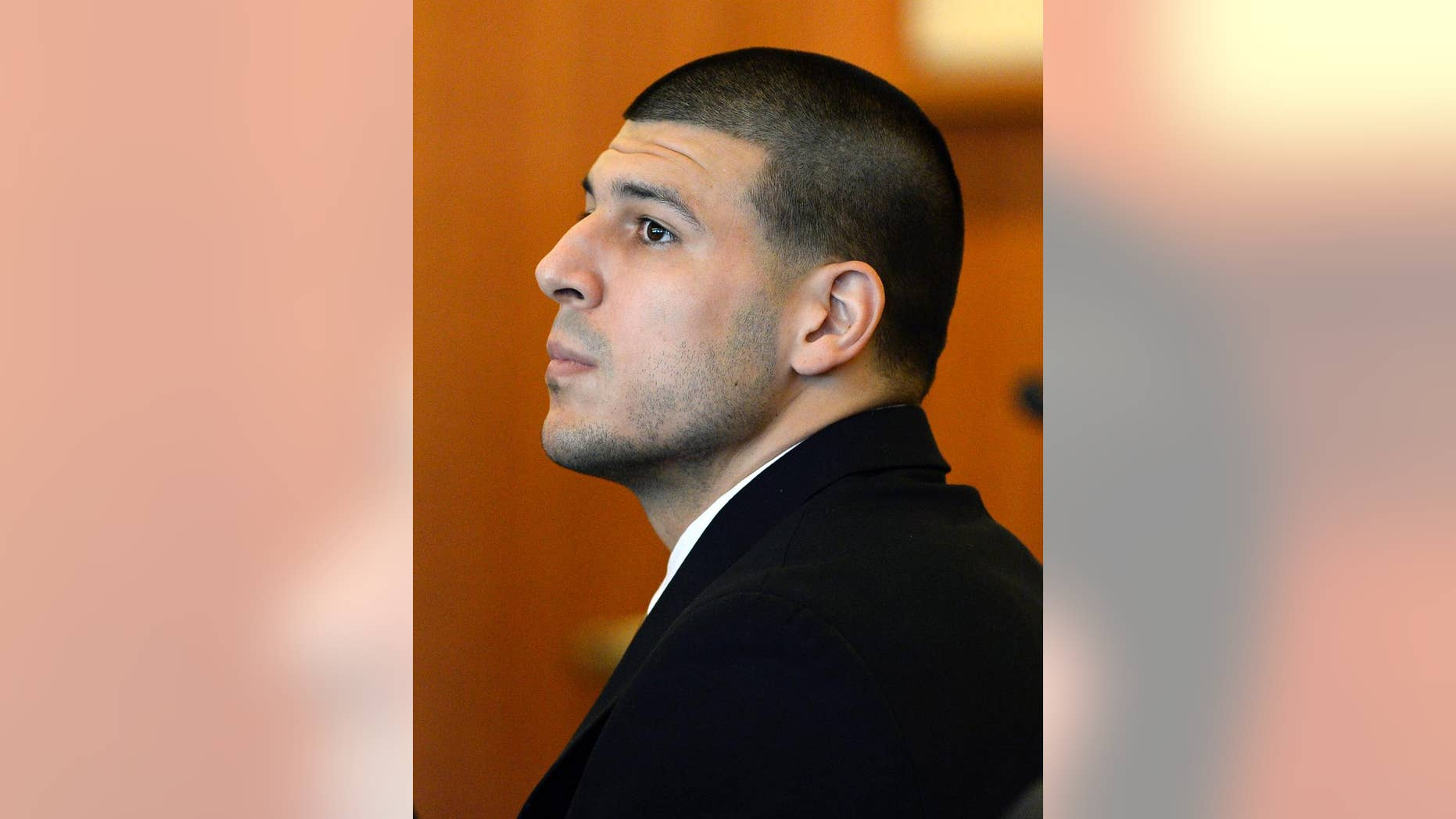 FILE - In this July 22, 2014, file photo, former New England Patriots' Aaron Hernandez watches during a hearing in Bristol County Superior Court in Fall River, Mass. Hernandez is charged with killing Odin Lloyd of Boston, whose body was found in an industrial park near Hernandez's home in North Attleborough in June 2013. During a hearing Monday, Aug. 11, 2014, Judge E. Susan Garsh took under advisement a motion by his defense to suppress evidence from some electronic devices seized from the former NFL football player's home during the investigation. (AP Photo/CJ Gunther, Pool, File)