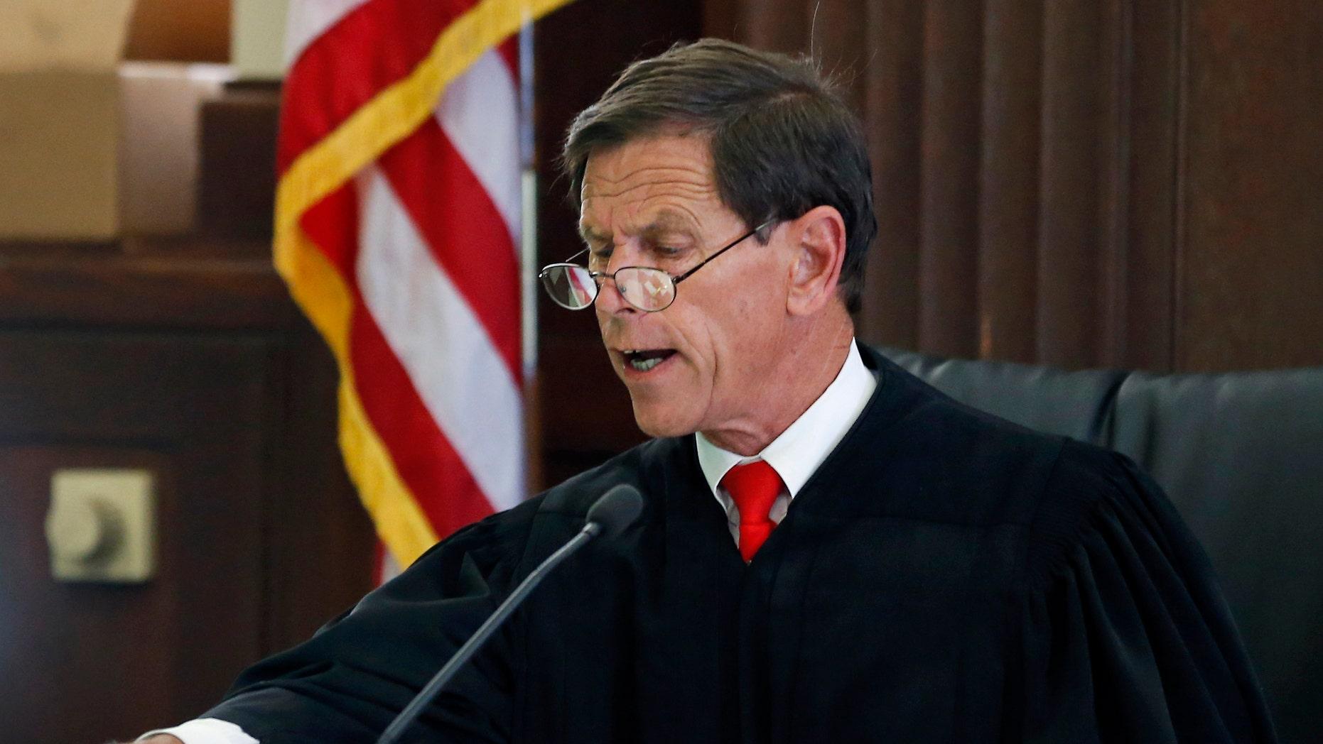 Judge Jeffrey Locke during a pretrial hearing Thursday, Aug. 14, 2014, in Suffolk Superior Court in Boston.
