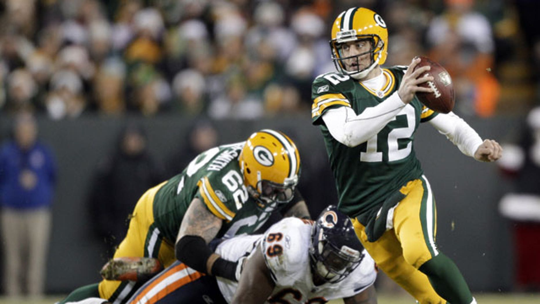 December 25, 2011: Green Bay Packers quarterback Aaron Rodgers scrambles during the second half of an NFL football game against the Chicago Bears in Green Bay, Wis.