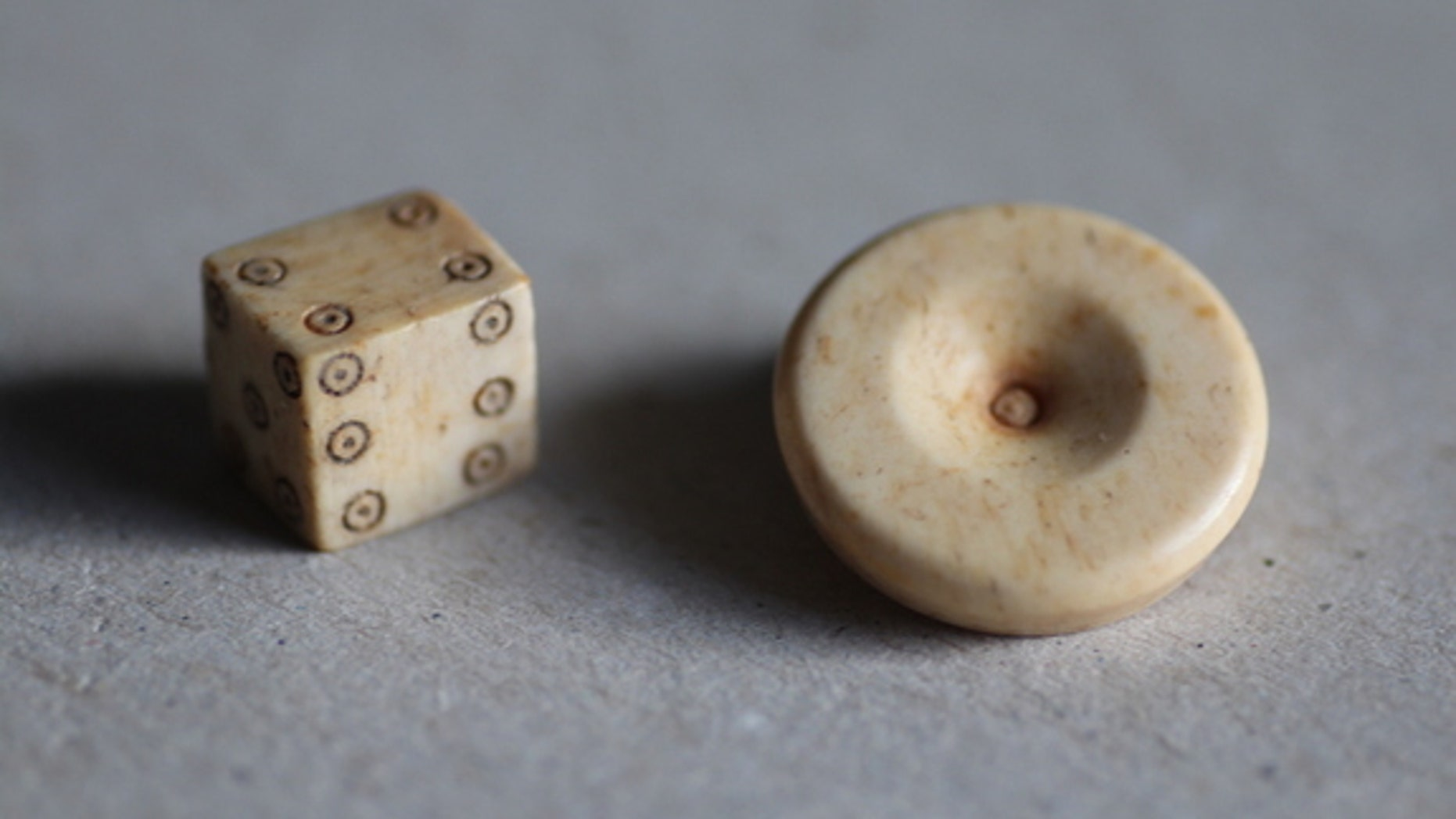 Dice design has changed very little since Roman times. Researchers found a gaming piece and die during excavations of the Roman settlement.