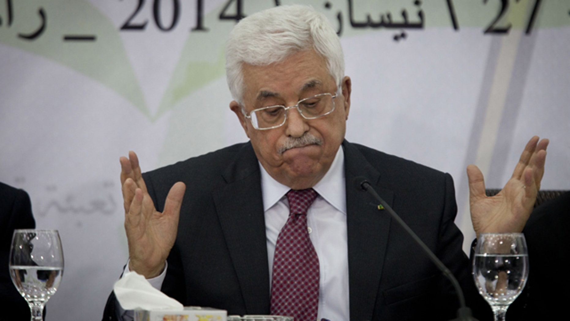 April 26, 2014: Palestinian President Mahmoud Abbas speaks during a meeting with the Palestinian Central Council, a top decision-making body, at his headquarters in the West Bank city of Ramallah.