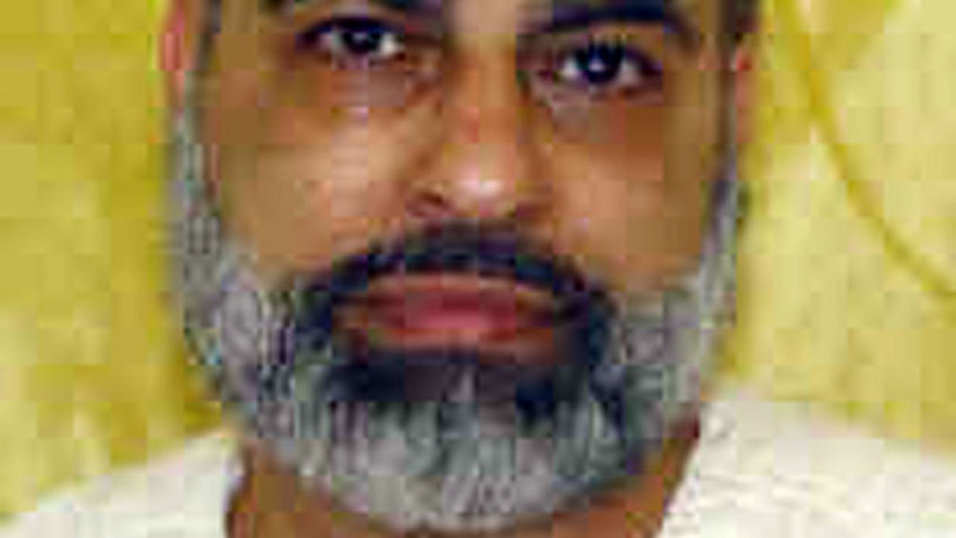 This undated file photo provided by the Ohio Department of Rehabilitation and Correction shows Abdul Awkal, convicted in the 1992 slayings of his estranged wife and brother-in-law at a courthouse in Cleveland's Cuyahoga County.
