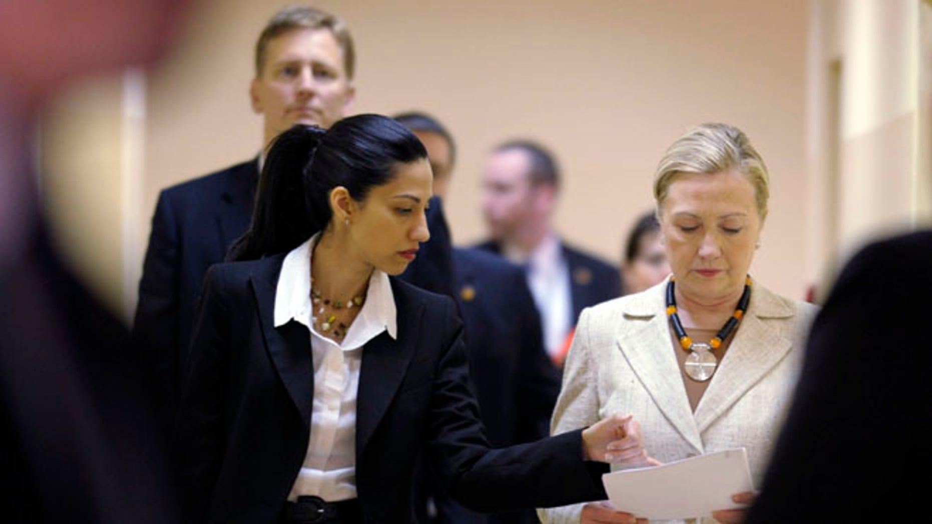 FILE: June 11, 2011: Huma Abedin with then-Secretary of State Hillary Clinton, Lusaka, Africa.