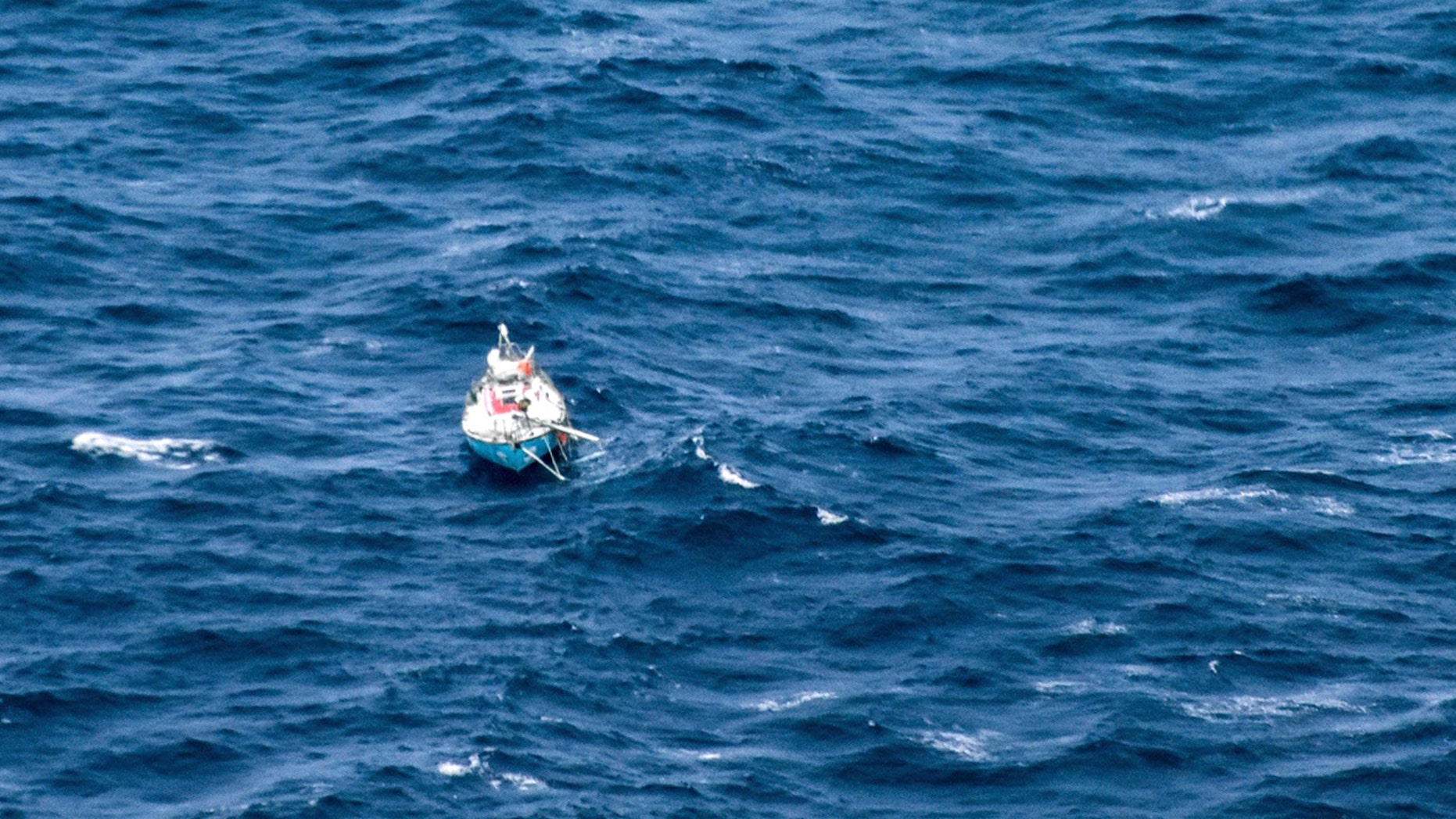 In this photo provided by the Australian Maritime Safety Authority on Monday, Sept. 24, 2018, the distressed yacht, Thuriya, with Indian sailor Abhilash Tomy on board, floats in the southern Indian Ocean. Tomy was injured and his yacht lost its mast in a storm on Friday.