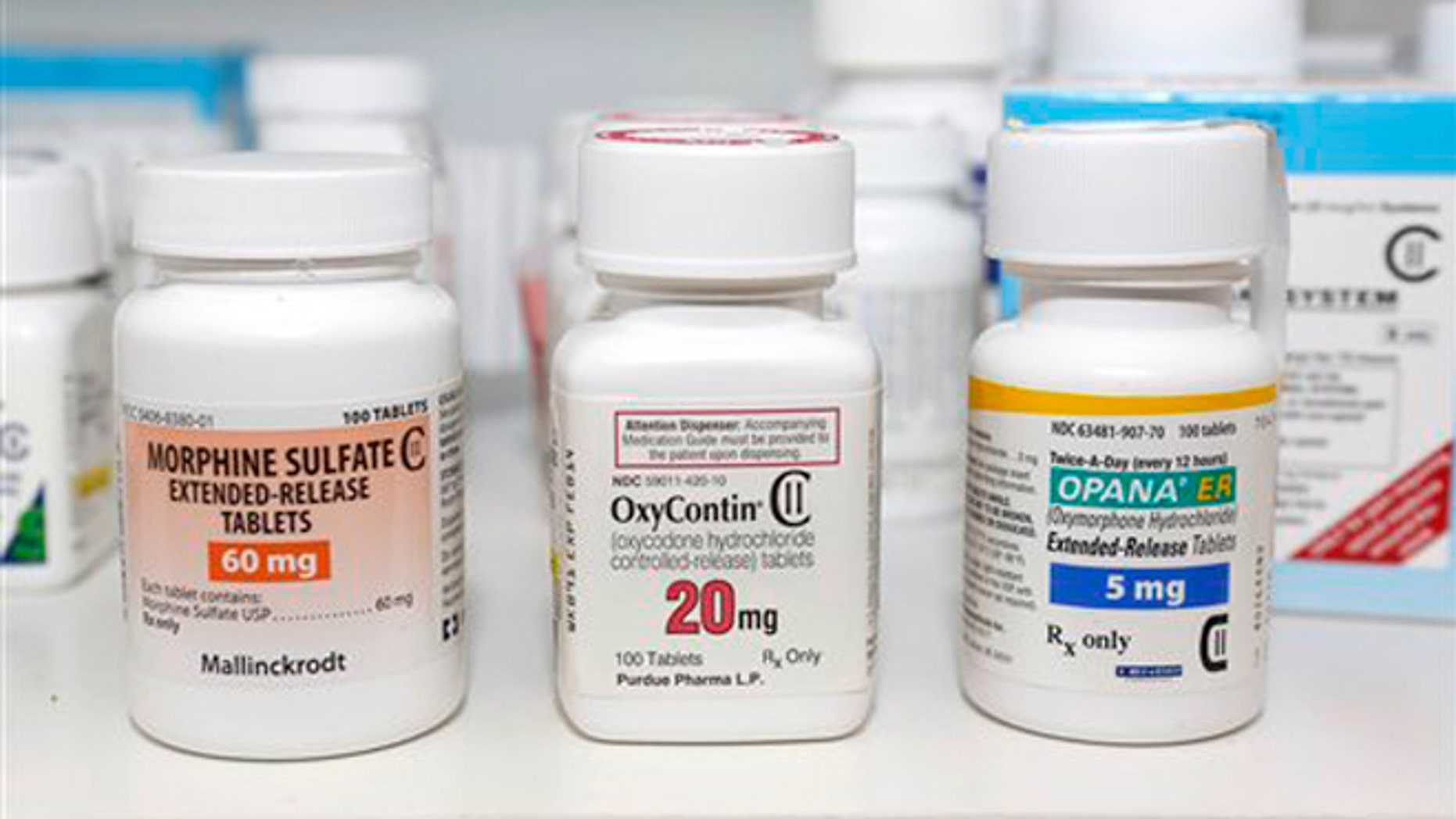 FILE -- Schedule 2 narcotics Morphine Sulfate, OxyContin and Opana are displayed for a photograph in Carmichael, Calif.