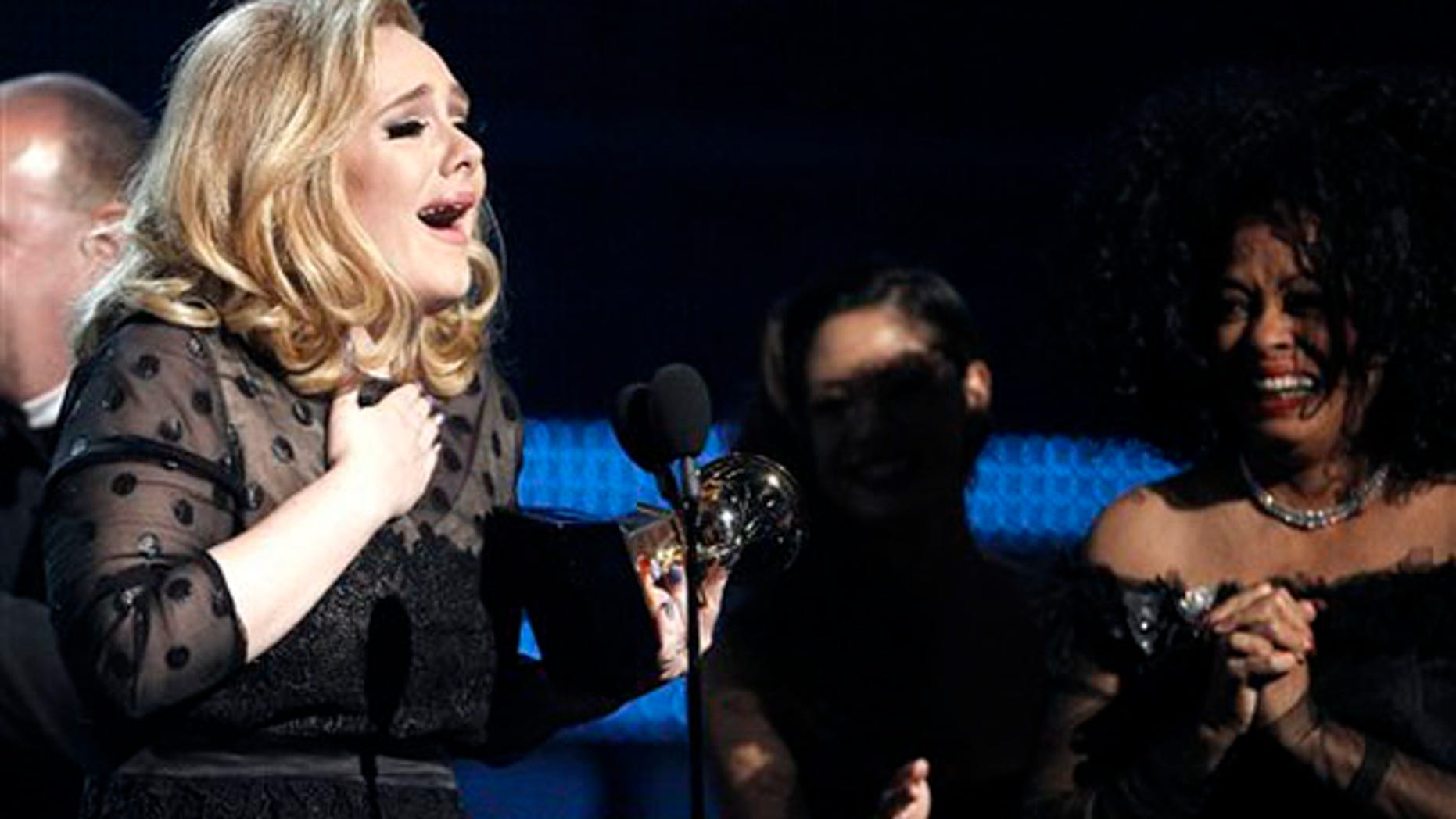 "Feb. 12, 2012: Adele accepts the award for record of the year for ""Rolling in the Deep"" during the 54th annual Grammy Awards."