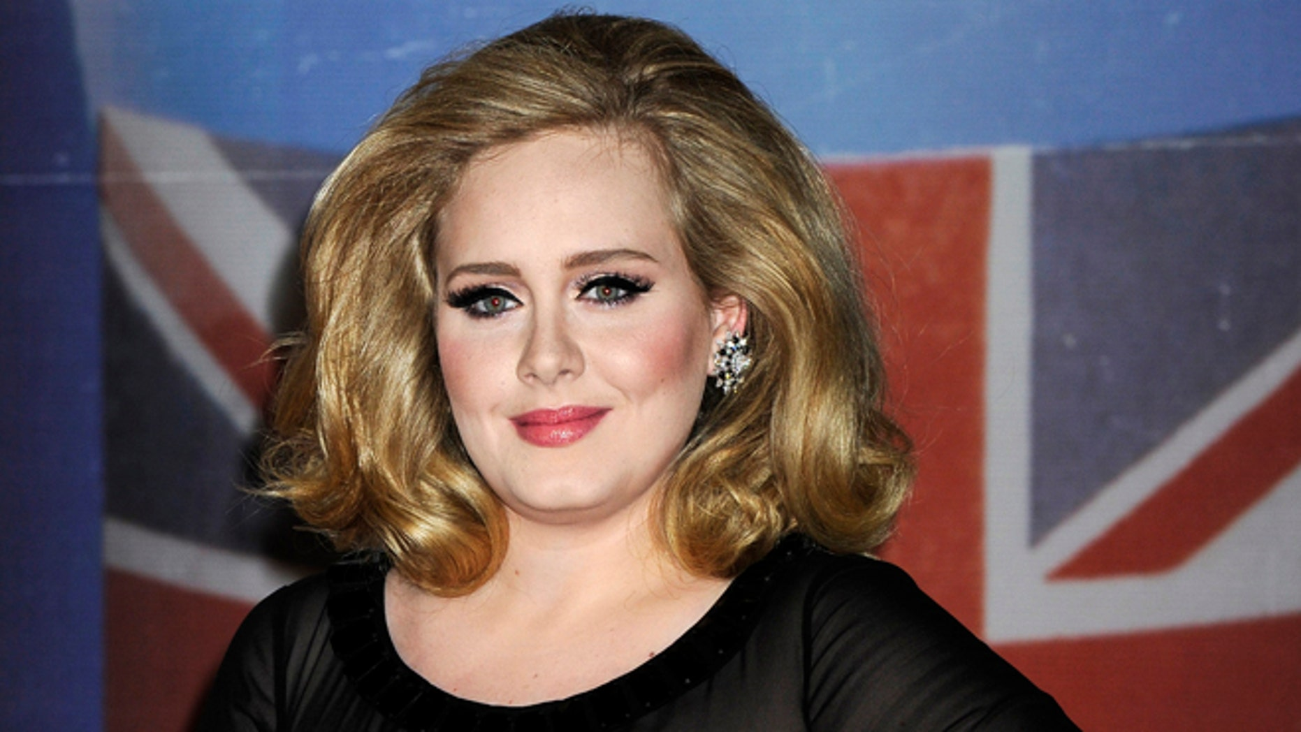 Feb. 21, 2012: In this file photo, performer Adele arrives for the Brit Awards 2012 at the O2 Arena in London.