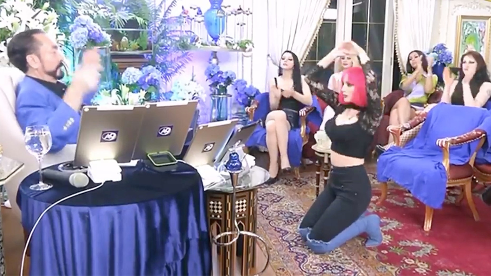 """Adnan Oktar, a controversial Turkish TV host known for giving his sermons while surrounded by a group of scantily clad women he called his """"kittens"""" was arrested on Wednesday."""