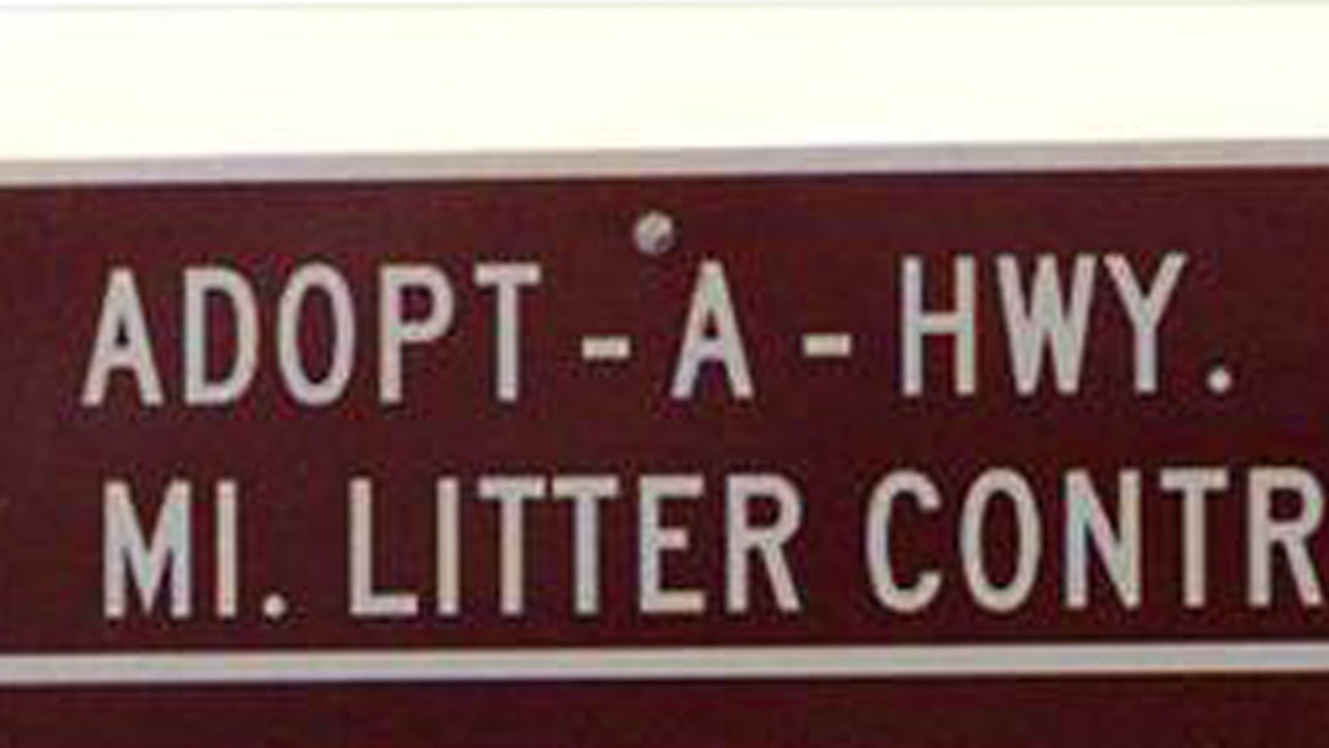 An ADOPT-A-HWY sign in Missouri.