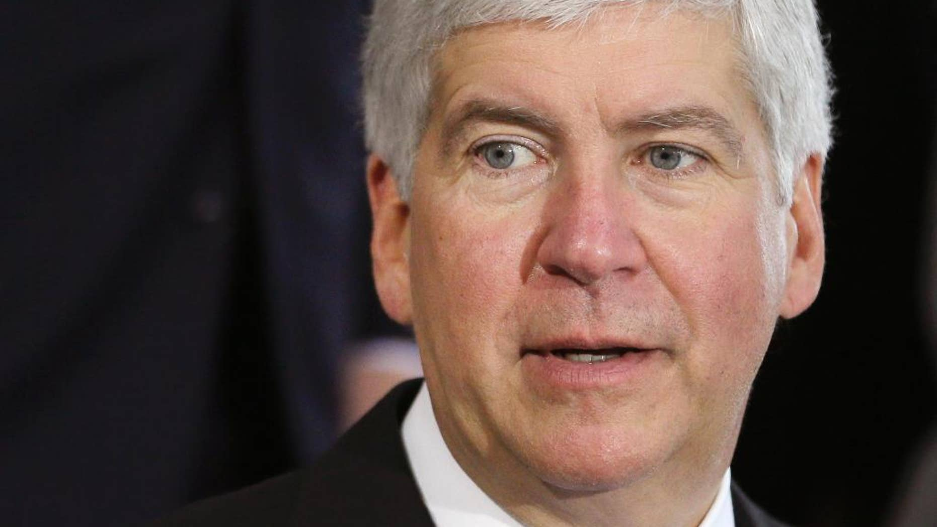 FILE - This June 20, 2014 file photo shows Michigan Gov. Rick Snyder during a ceremony in Detroit. Snyder on Thursday, June 11, 2015 signed a law letting private adoption agencies with state contracts decline to participate in referrals against their religious beliefs, despite criticism that it amounts to government-sanctioned discrimination against gay couples. (AP Photo/Carlos Osorio, file)