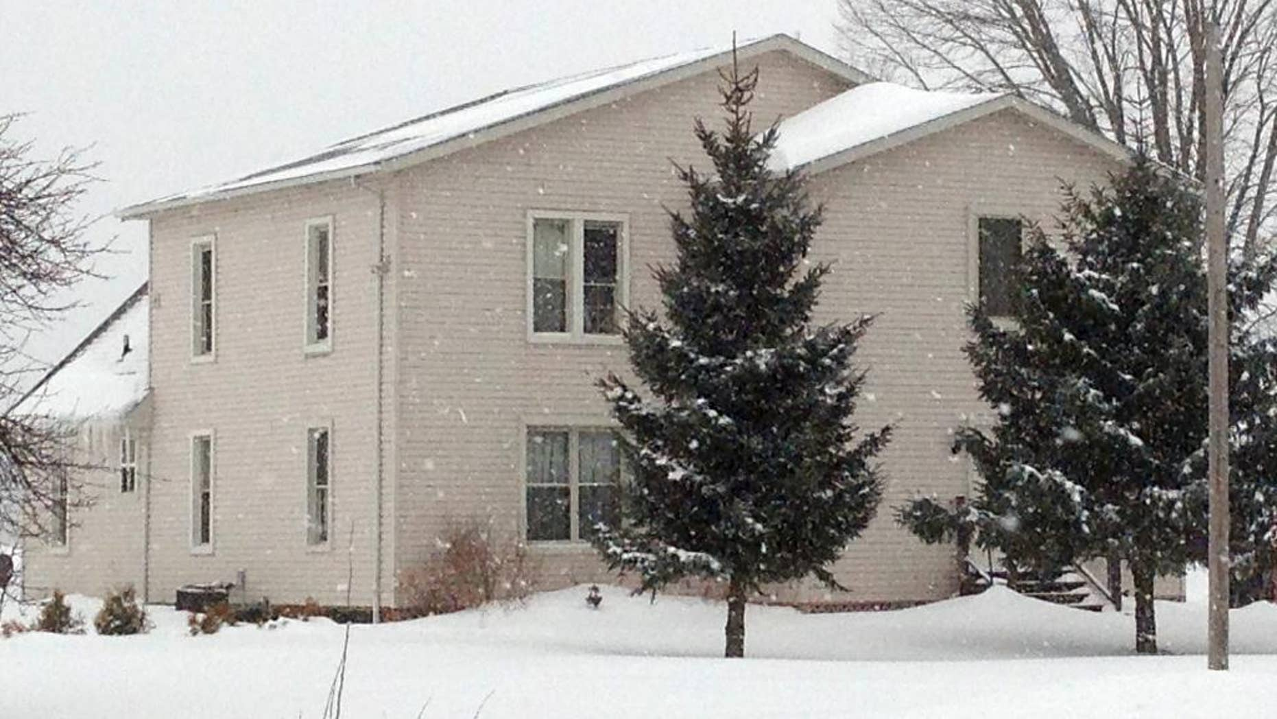 The house where a husband and wife lived with their four adopted children is shown, Wednesday, March 4, 2015, in Ashtabula, Ohio. The husband and wife pleaded not guilty to charges alleging they kept three adopted children locked in bedrooms most of the time and gave them little to eat. Prosecutors in Ashtabula County say the pair beat their two girls and their mentally challenged adult son. They were indicted last week on other charges. Prosecutors say the abuse occurred between September 2011 and September 2013. (AP Photo/Mark Gillispie)