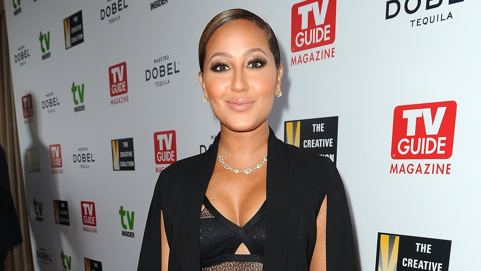 WEST HOLLYWOOD, CA - SEPTEMBER 18:  Adrienne Bailon arrives at the Television Industry Advocacy Awards benefitting The Creative Coalition hosted by TV Guide Magazine and TVInsider with support from Maestro Dobel Tequila, produced by AMPitLIVE at Sunset Tower Hotel on September 18, 2015 in West Hollywood, California.  (Photo by Joshua Blanchard/Getty Images for Maestro Dobel Tequila)