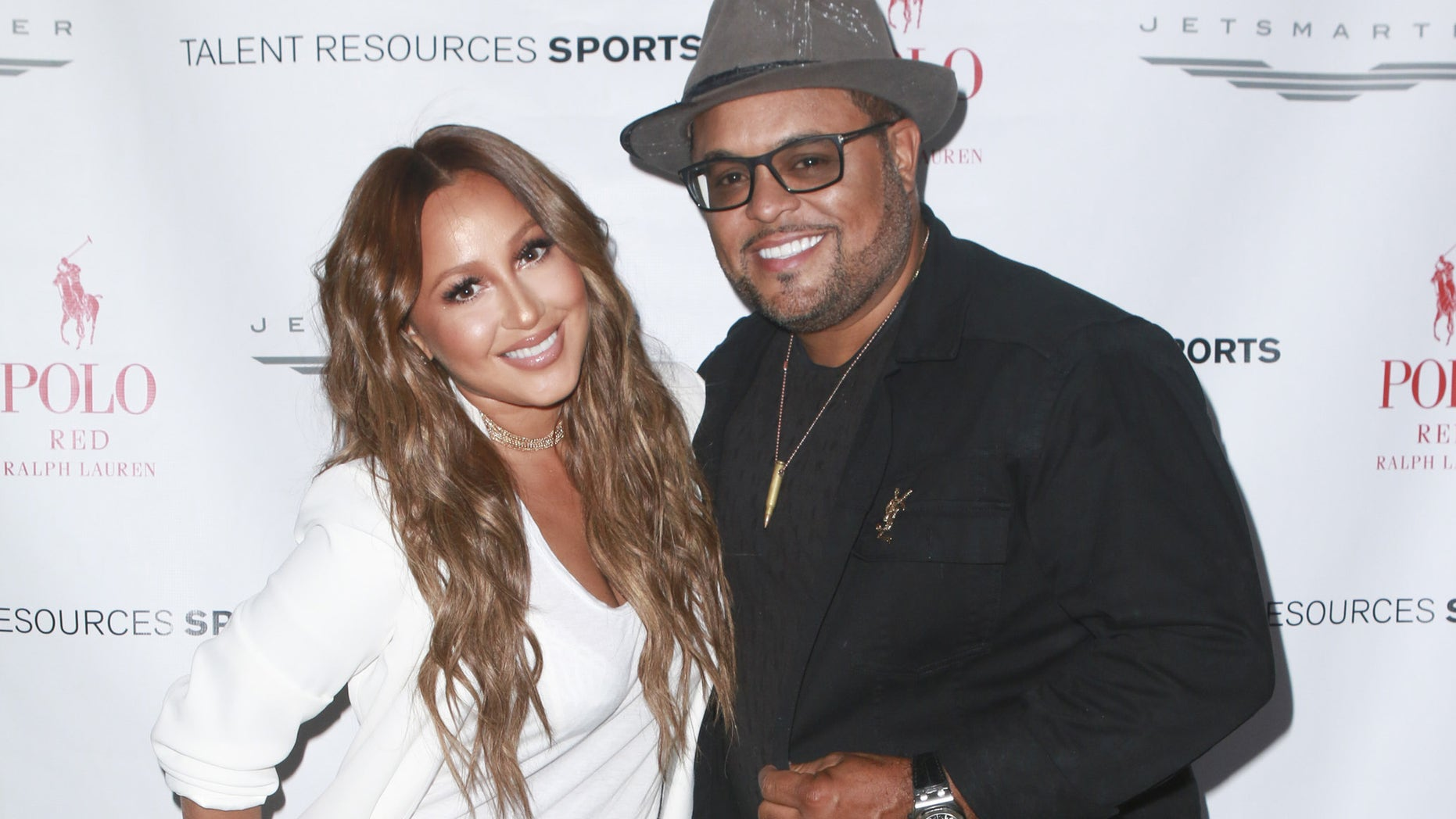 LOS ANGELES, CA - JULY 12: TV Personality Adrienne Bailon (L) and Israel Houghton attends 2016 ESPYs Talent Resources Sports Luxury Lounge on July 12, 2016 in Los Angeles, California.  (Photo by Tasia Wells/Getty Images for Talent Resources Sports )