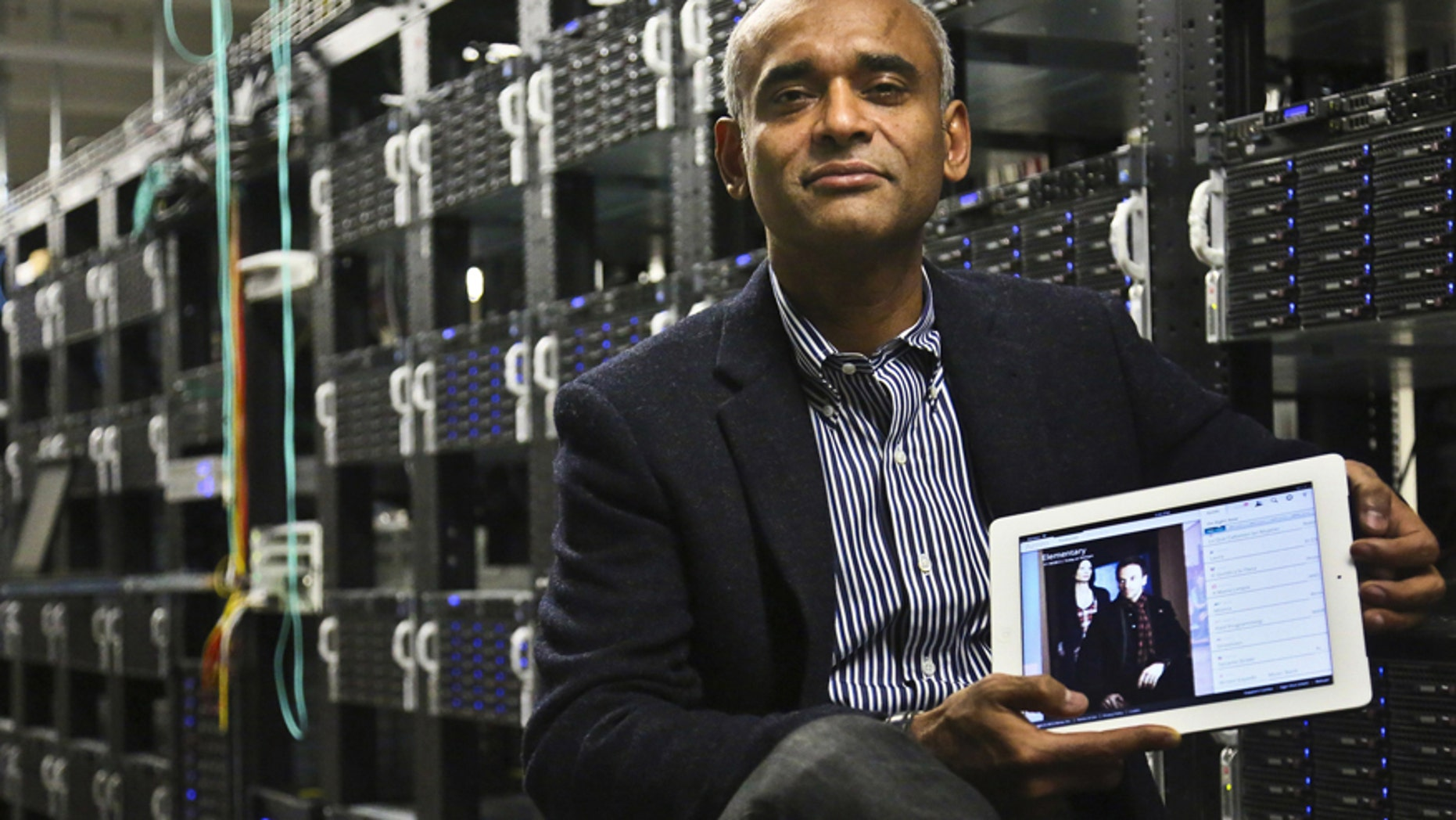 This Dec. 20, 2012 file photo shows Chet Kanojia, founder and CEO of Aereo, Inc., holding a tablet displaying his company's technology.