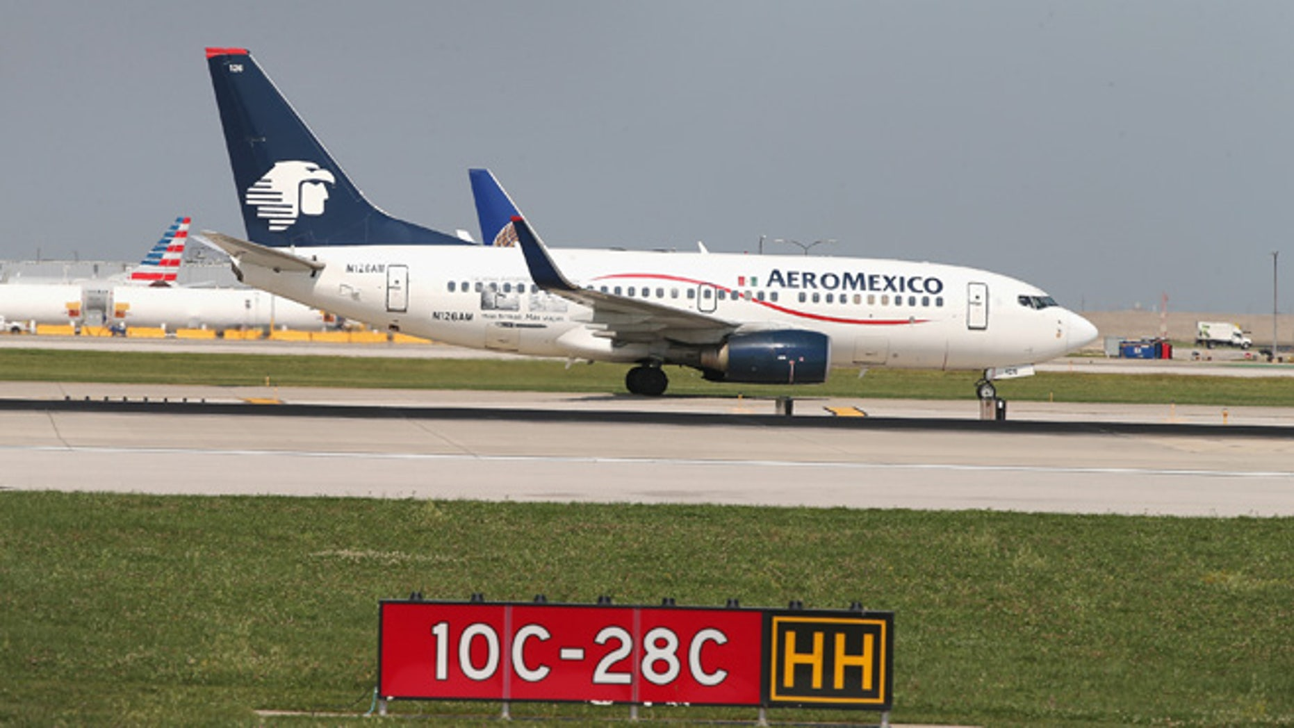 CHICAGO, IL - SEPTEMBER 19: An AeroMexico jet taxis at O'Hare International Airport on September 19, 2014 in Chicago, Illinois. In 2013, 67 million passengers passed through O'Hare, another 20 million passed through Chicago's Midway Airport, and the two airports combined moved more than 1.4 million tons of air cargo. (Photo by Scott Olson/Getty Images)