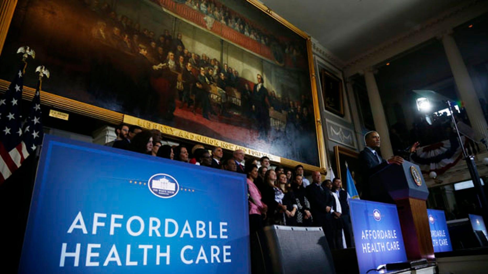 President Barack Obama speaks at Boston's historic Faneuil Hall, Wednesday, Oct. 30, 2013.