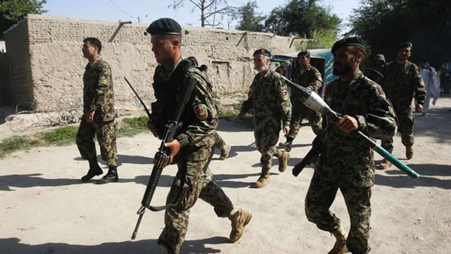 April 15, 2012: Afghan National Army soldiers arrive at the Provincial Reconstruction Team (PRT) after gunmen launched a coordinated attack in Jalalabad province.