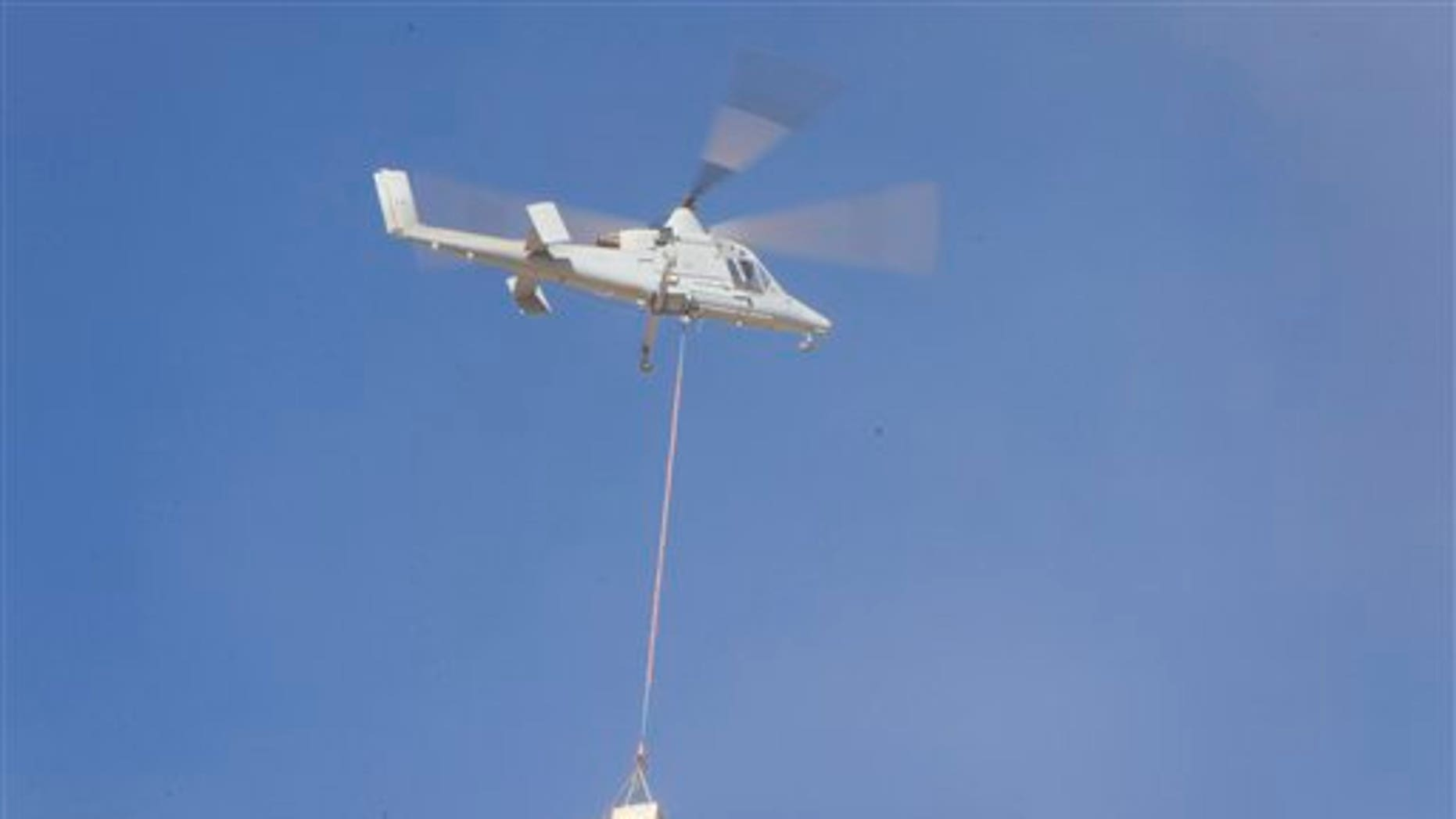 Dec. 17, 2011: A K-MAX pilotless freight helicopter, a detachment from Marine Unmanned Aerial Vehicle Squadron 1, transports cargo in Camp Dwyer, Helmand province, south of Kabul, Afghanistan.