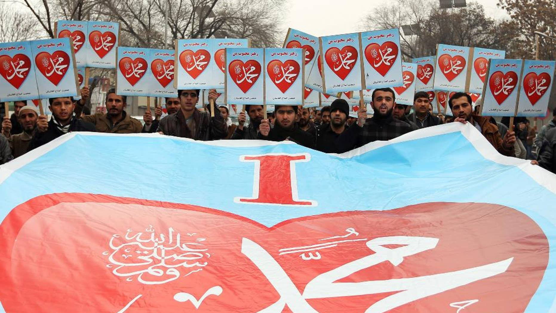 """Afghans hold posters that read, """"I love Muhammad,"""" during a protest against caricatures published in French magazine Charlie Hebdo outside the French Embassy, in Kabul, Afghanistan, Thursday, Jan. 22, 2015. Around 100 people have demonstrated in the Afghan capital against the publishers of the French satirical magazine Charlie Hebdo, accusing them of blasphemy. (AP Photo/Rahmat Gul)"""