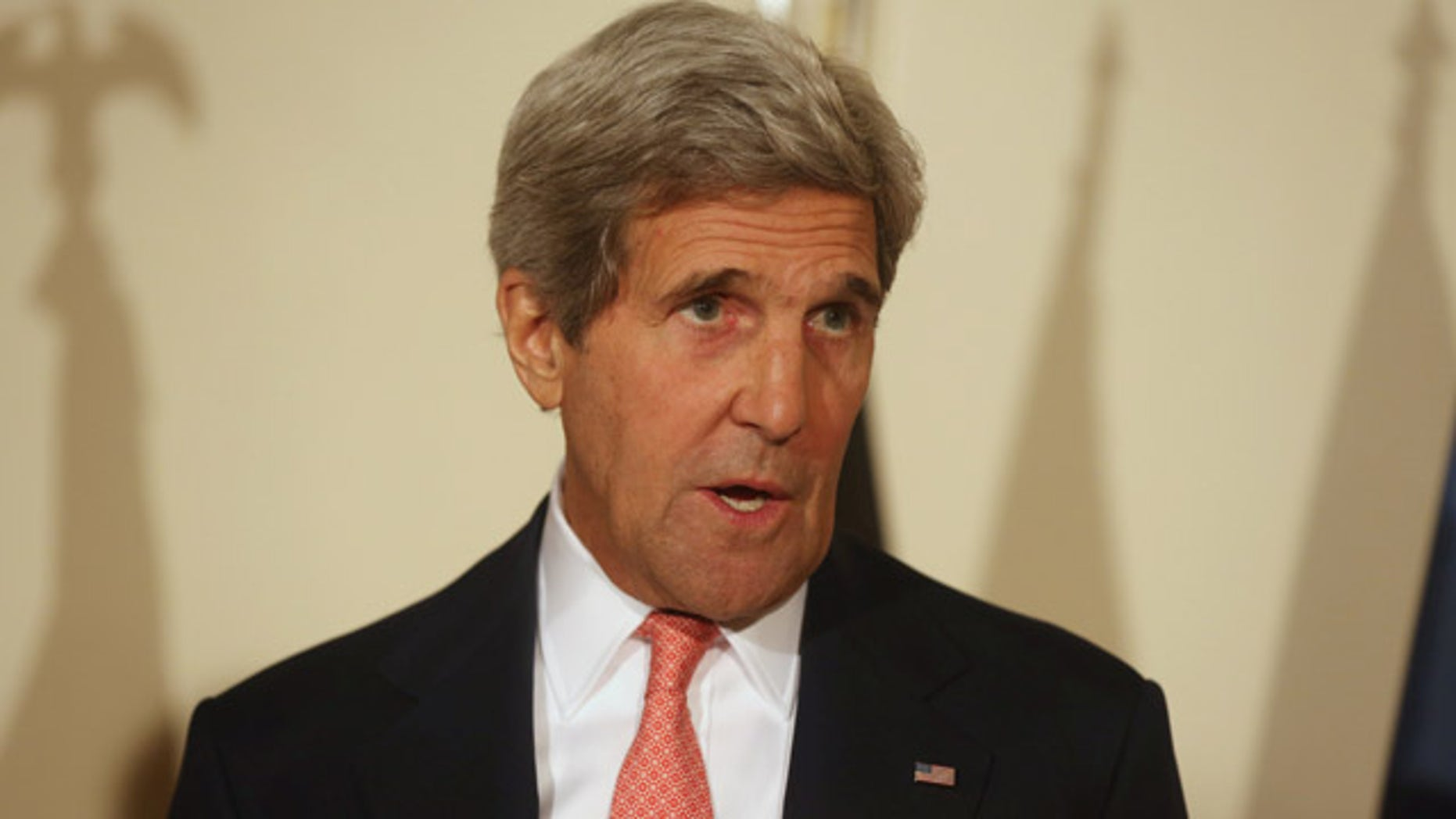 July 12, 2014: U.S. Secretary of State John Kerry speaks during a joint press conference in Kabul, Afghanistan (AP Photo/Rahmat Gul)
