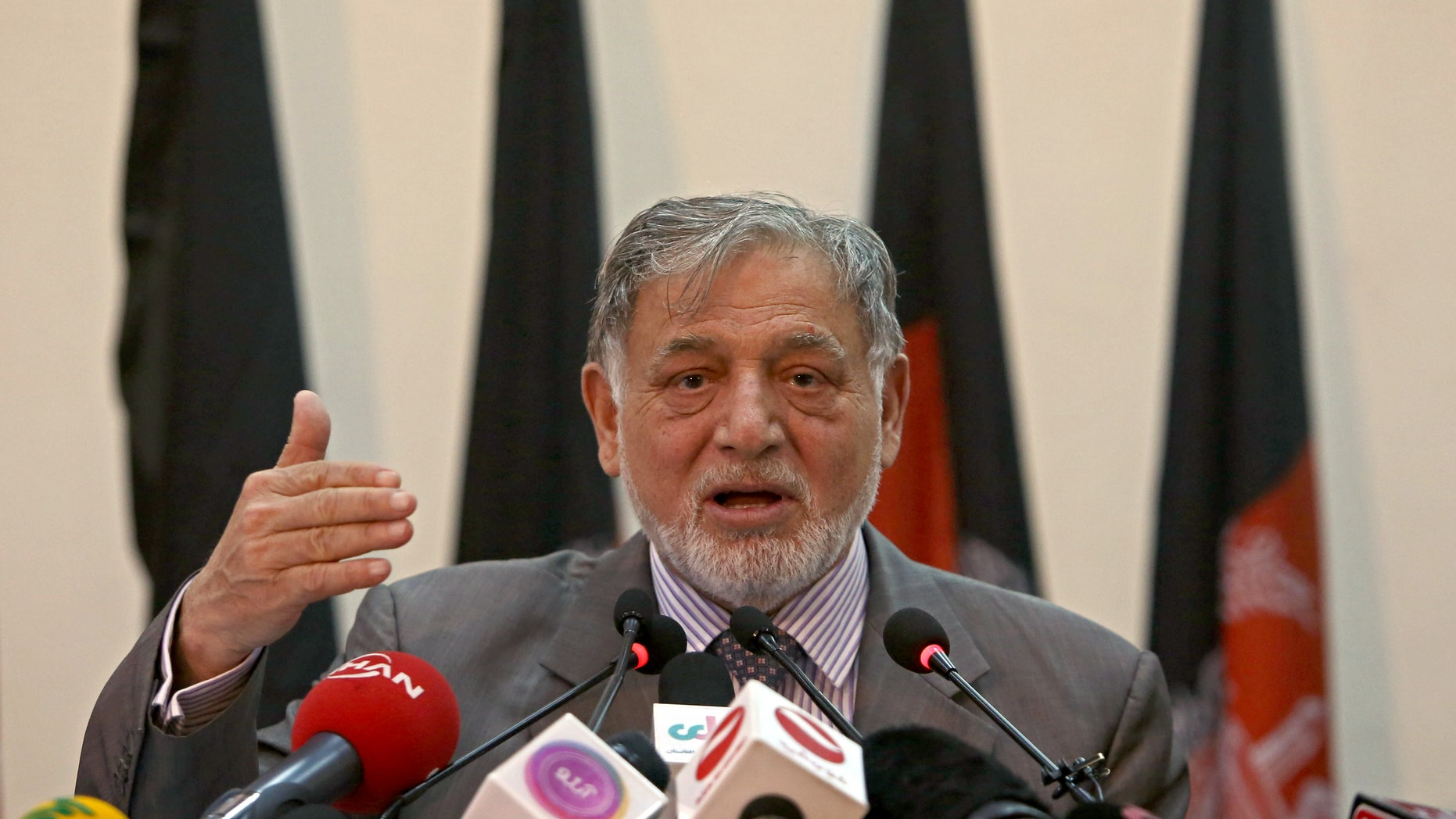 July 7, 2014 - Ahmad Yousuf Nouristani, chairman of the Independent Election Commission, speaks in Kabul, Afghanistan. Aghanistan's election commission says that former finance minister Ashraf Ghani Ahmadzai has the lead in preliminary results from a disputed presidential runoff vote.