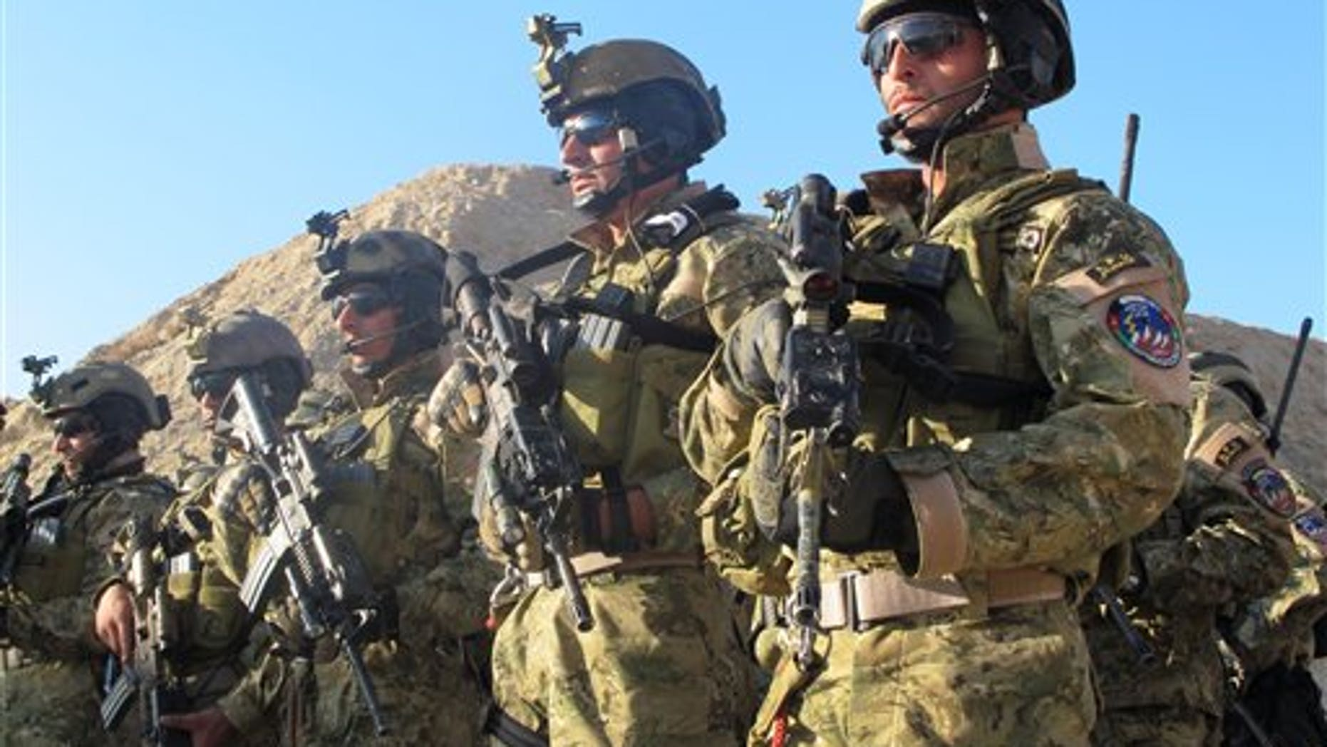 Dec. 15: Members of the growing Afghan special forces stand in formation after conducting a practice raid at a training field on the outskirts of Kabul, Afghanistan.