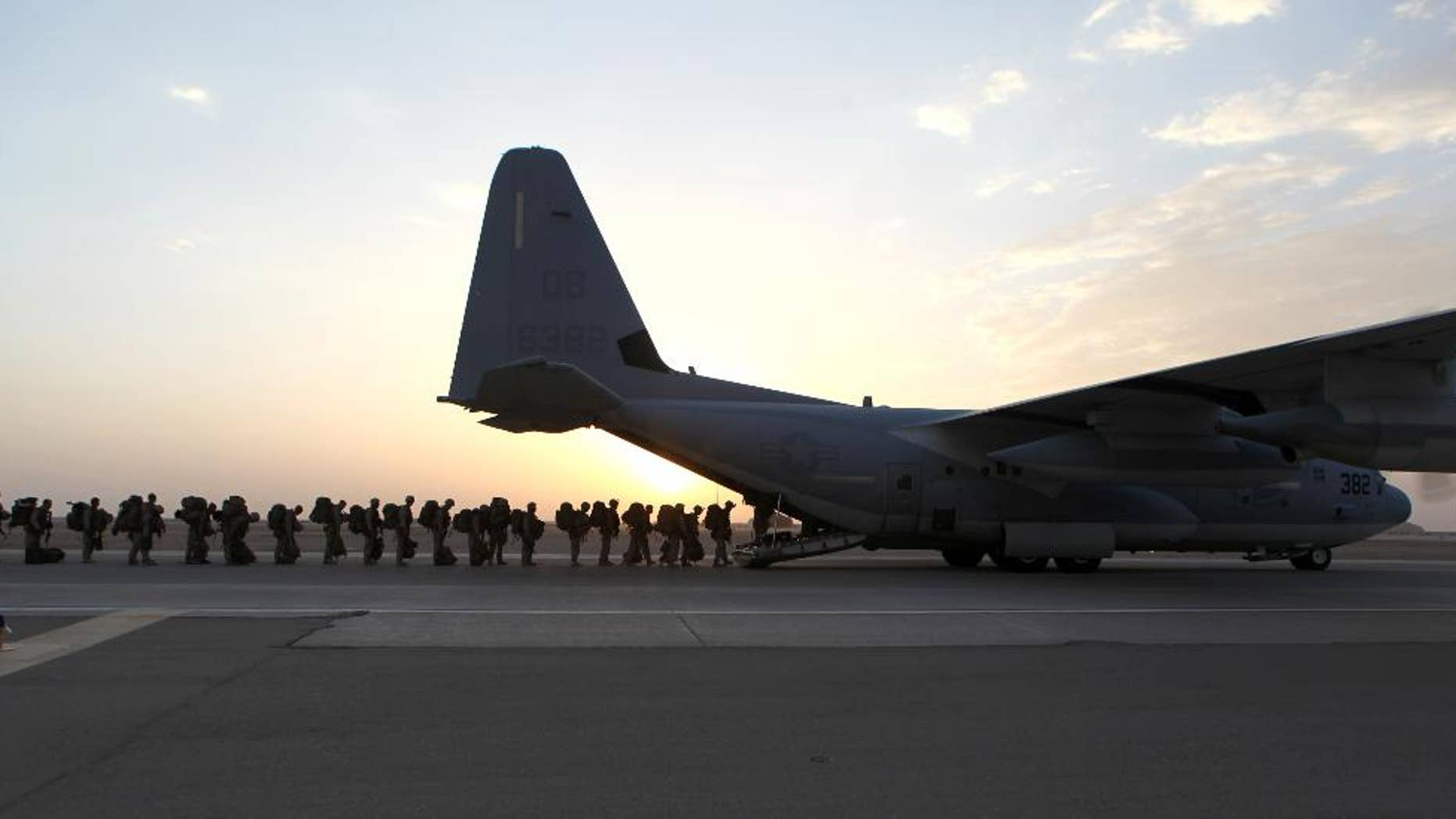 This handout photo provided Defense Department shows Marines and sailors with Marine Expeditionary Brigade – Afghanistan load onto a KC-130 aircraft on the Camp Bastion, Afghanistan flightline, Monday, Oct. 27, 2014. The handover of the U.S. Marines' main base to Afghan control in the hardscrabble Helmand province is more than a signal that America's longest war is ending. It is a reminder of the enormous loss and sacrifice by Marines who swept in as part of President Barack Obama's surge of forces against a resurgent Taliban in 2009.  (AP Photo/Staff Sgt. John Jackson, Defense Department, US Marines)
