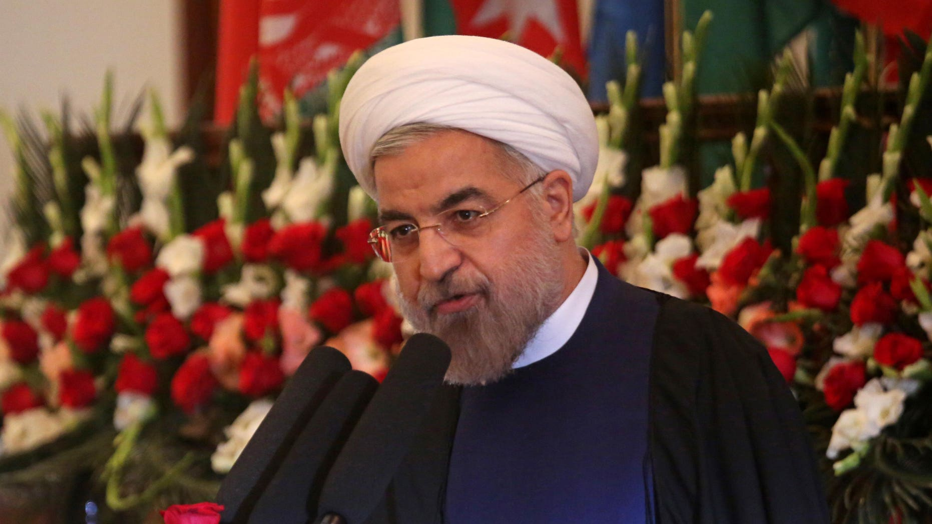 """Iranian President Hasan Rouhani speaks during a ceremony celebrating the Persian New Year, Nowruz at the presidential palace in Kabul, Afghanistan, Thursday, March 27, 2014. In his first visit to Afghanistan as Iran's president, Rouhani has called for regional unity while at the same time saying international forces brought """"destruction"""" to Afghanistan. (AP Photo/Massoud Hossaini)"""