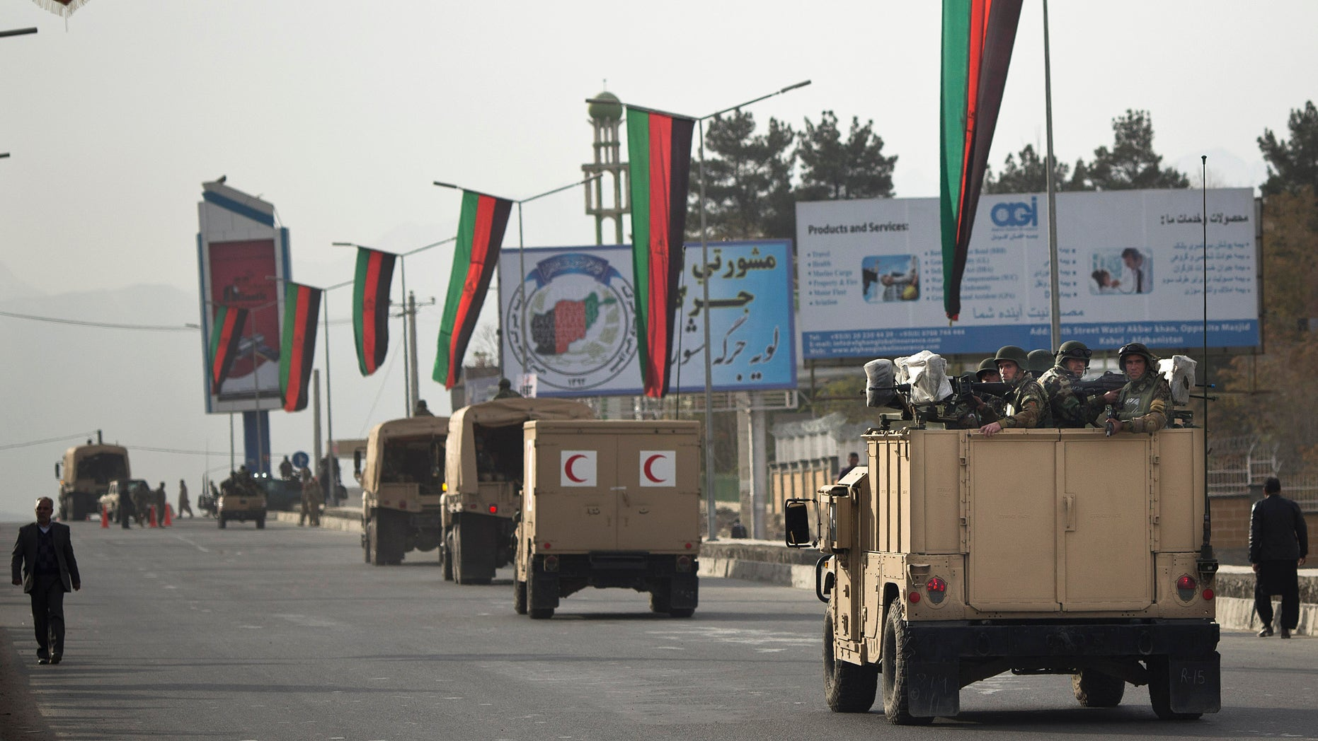 Nov. 18, 2013 -  A convoy of Afghan soldiers moves into the area where the Loya Jirga will take place later this week in Kabul, Afghanistan. Security stepped up after a blast on Nov. 16. Thousands of prominent Afghans are scheduled to meet in the Afghan capital to debate a contentious security agreement with the US.