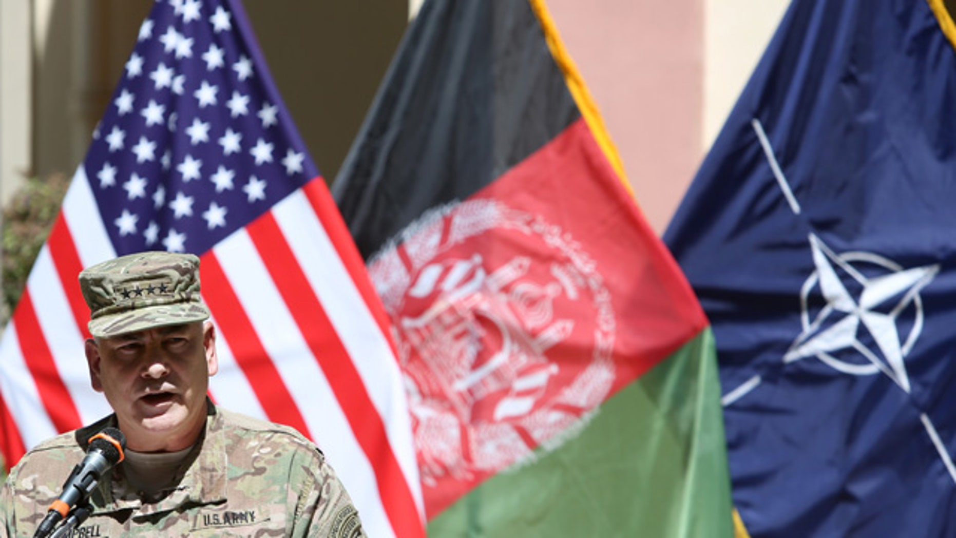 Sept. 11, 2015: Commander of the International Security Assistance Force (ISAF), Gen. John Campbell, speaks during a memorial ceremony on the fourteenth anniversary of the 9-11 terrorist attacks on the United States at the headquarters of the International Security Assistance Force, in Kabul, Afghanistan. (AP Photo/Rahmat Gul)