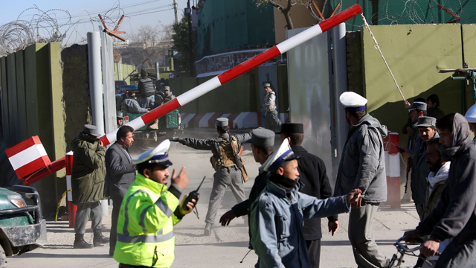 Nov. 9, 2014: Afghan Police inspect the site of a suicide attack in Kabul. A bomb exploded on Sunday morning at the police headquarters, killing at least one officer and wounding another six, officials said. (AP Photo/Rahmat Gul)