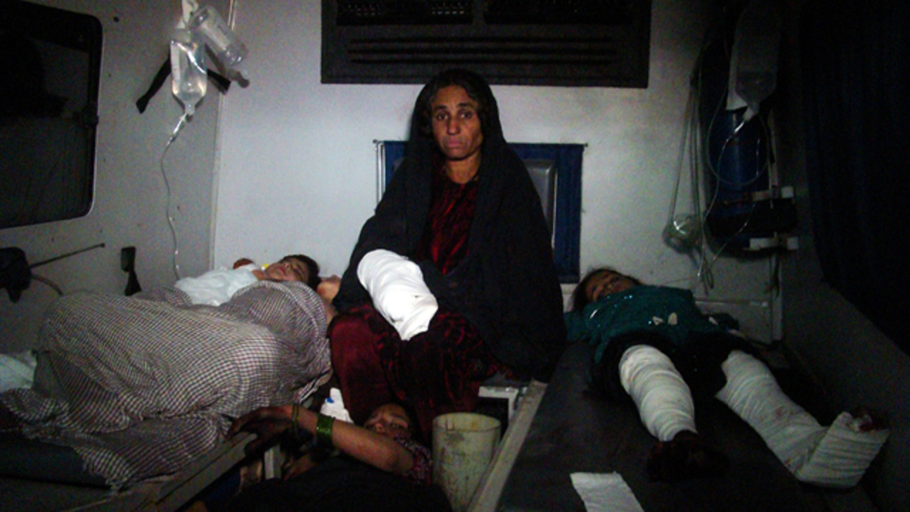 Dec. 31, 2014: Injured Afghan children are treated at a hospital in Helmand province, south of Kabul. A rocket fired amid fighting between Taliban insurgents and Afghan soldiers killed at least 26 people at a nearby wedding party Thursday night, authorities said, a grim end to a year that saw the end of the 13-year U.S.-led combat mission there. (AP Photo/Abdul Khaliq)