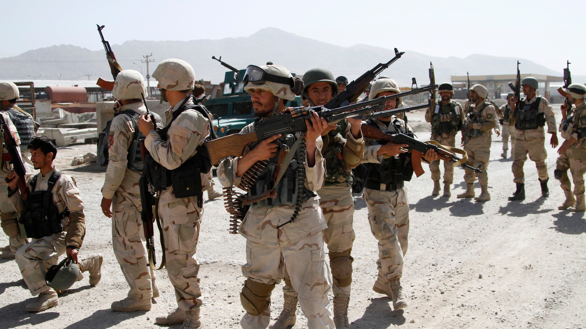 June, 10, 2013 - Afghan military soldiers stand guard as Taliban fighters attacked near Kabul airport, Afghanistan. 7 heavily armed Taliban insurgents launched a pre-dawn attack near Afghanistan's main airport, apparently targeting NATO's airport headquarters.