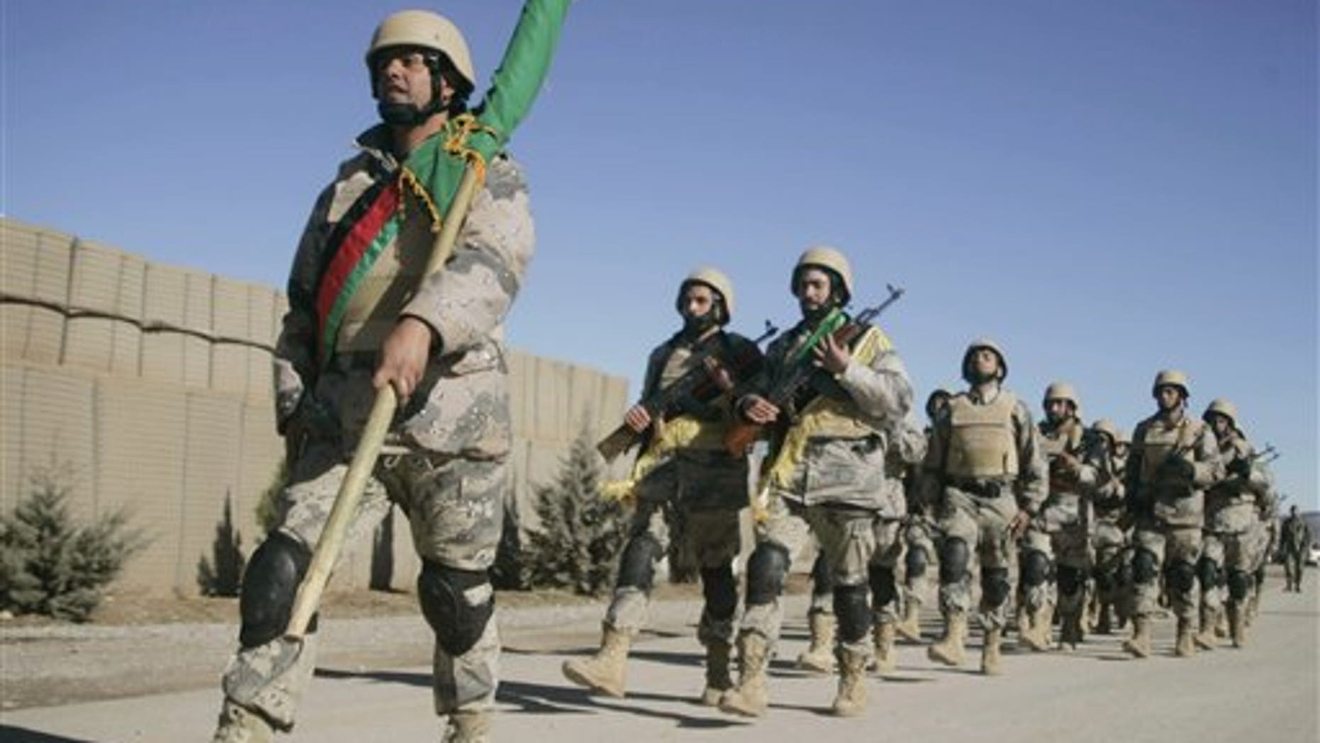 Jan. 16: Afghan border policemen march to attend at the ceremony of transfer of authority from the NATO led International Security Assistance Force troops to Afghan security forces in Guzara, Herat province, west of Kabul, Afghanistan.