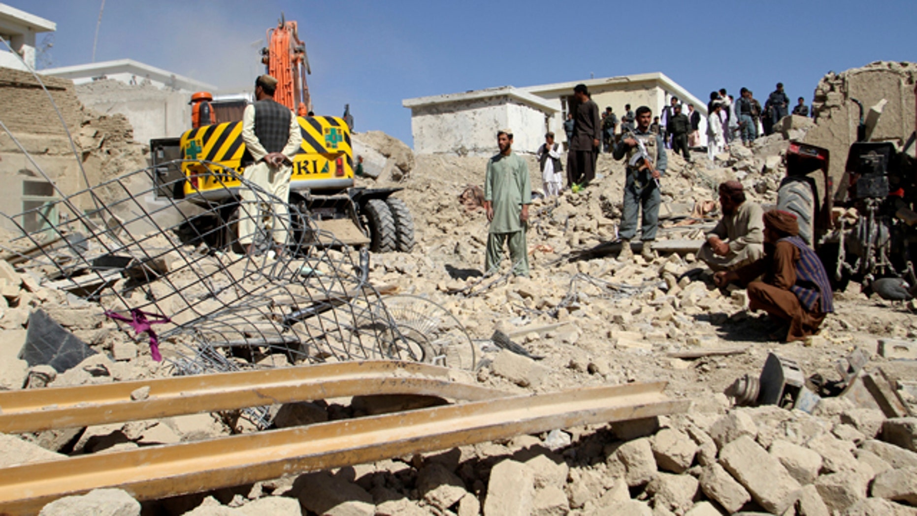 April 21, 2015: Afghan security forces work at the site of a bombing in Kandahar, south of Kabul. (AP Photo)