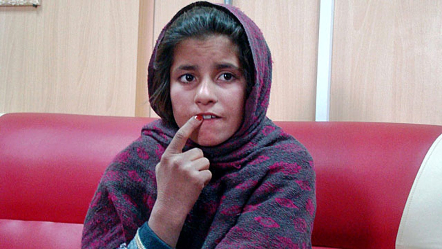 January 6, 2014: An Afghan girl named Spozhmai is held in a border police station in the Khan Neshin district in the southeastern part of Helmand province, Afghanistan. The 10-year-old told police that her brother, who she said is a Taliban commander, wrapped her in an explosives-packed vest but that she refused to blow herself up at a checkpoint in Helmand province. The Taliban denied the alleged plot. (AP Photo/Abdul Khaleq)