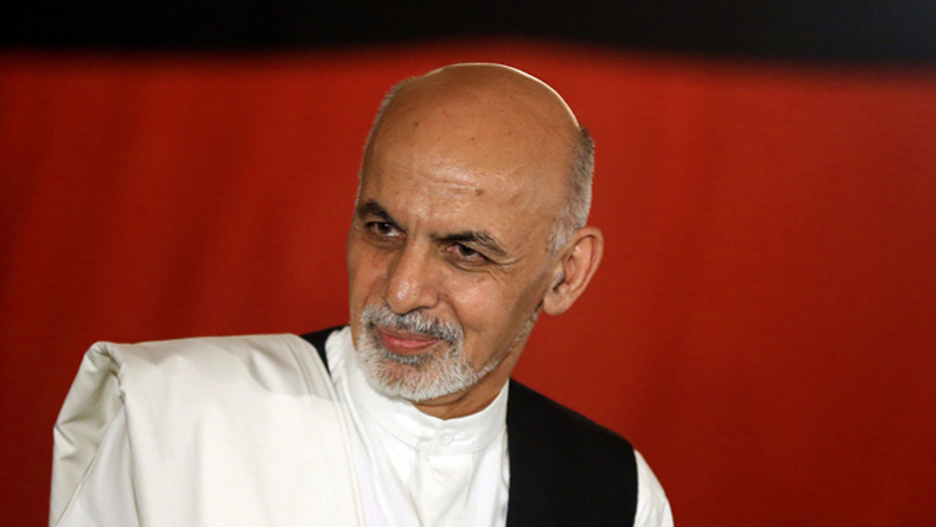 FILE - In this file Wednesday, Sept. 10, 2014 photo, Afghan presidential candidate Ashraf Ghani Ahmadzai speaks during a news conference at his residence in Kabul. (AP Photo/Massoud Hossaini)