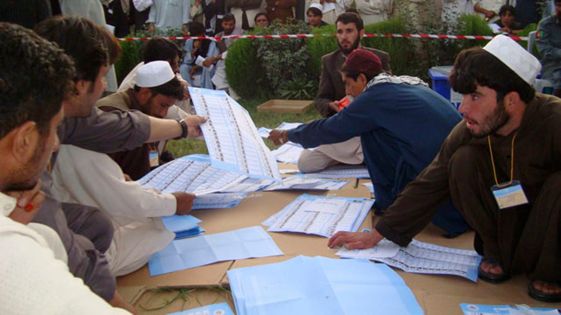 Sept. 20, 2010: Election workers count votes at the regional counting center in Khost, Afghanistan.