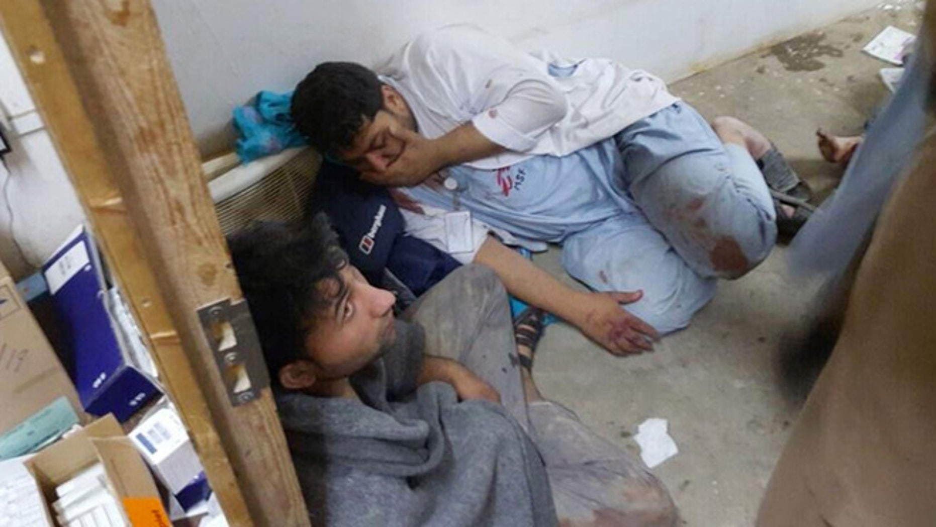 Oct. 3, 2015: Injured Doctors Without Borders staff are seen after explosions near their hospital in the northern Afghan city of Kunduz.