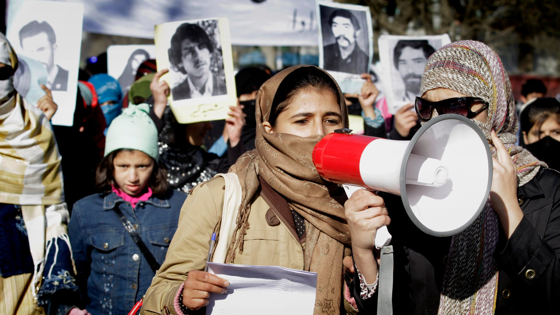 Dec. 10: Several hundred demonstrators shouted for justice and peace Friday in the Afghan capital, just hours before a suicide car bomber blew himself up in the east killing two civilians.