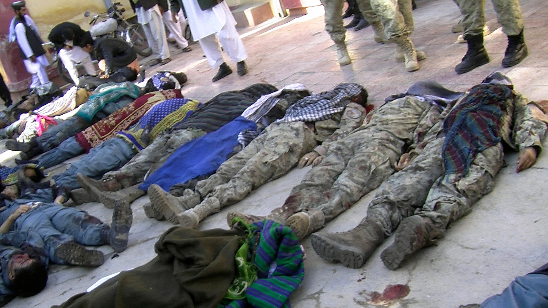 Oct. 26, 2012 - Bodies of victims of a suicide attack lie in a courtyard of a hospital in Maymana, northwest of Kabul, Afghanistan.