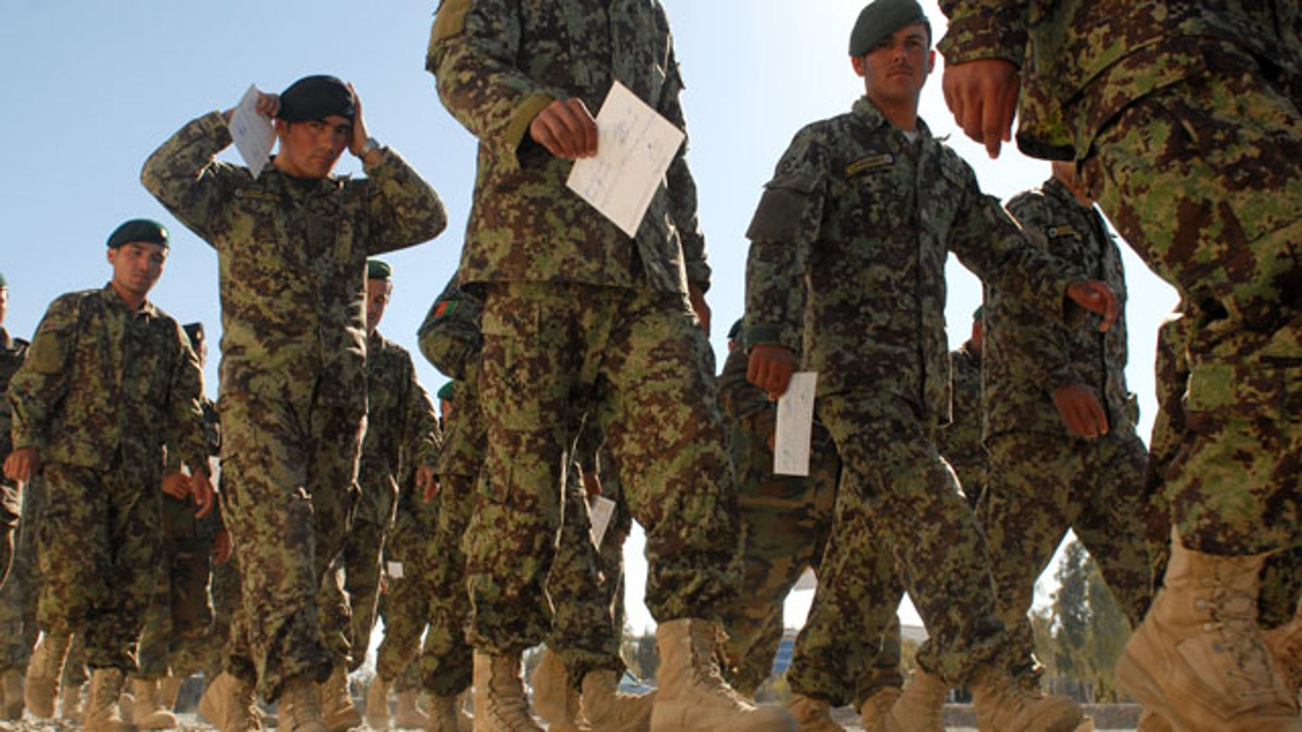 Jan. 6:  Afghan National Army soldiers hold their graduation certificates after graduating from a senior-enlisted professional development course in Kandahar, Afghanistan.  Officials said Jan. 6 Defense Secretary Robert Gates has decided to send an additional 1,400 Marine combat forces to Afghanistan.