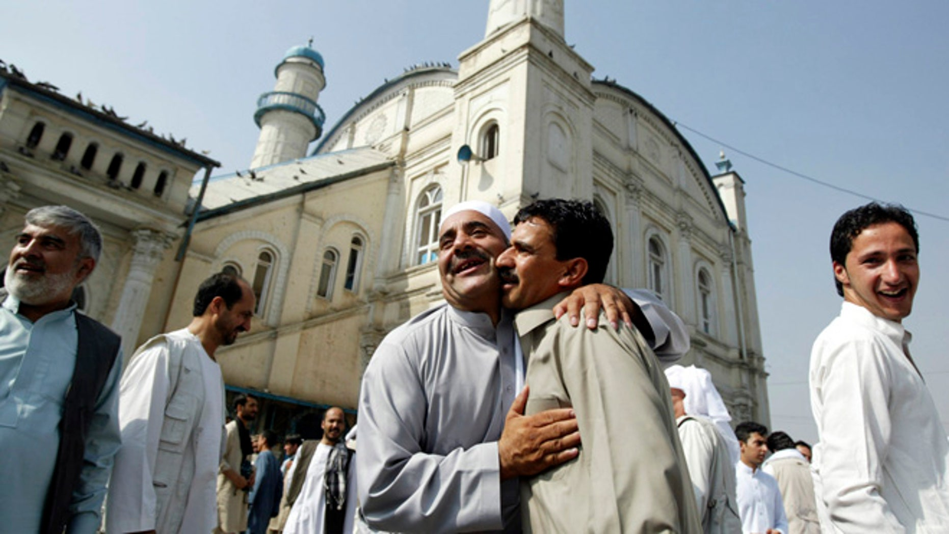 Aug. 8, 2013: Afghans celebrate the Eid al Adha each other after offering Eid al Adha's prayers outside Shah-e-Dushamshera mosque in Kabul, Afghanistan.