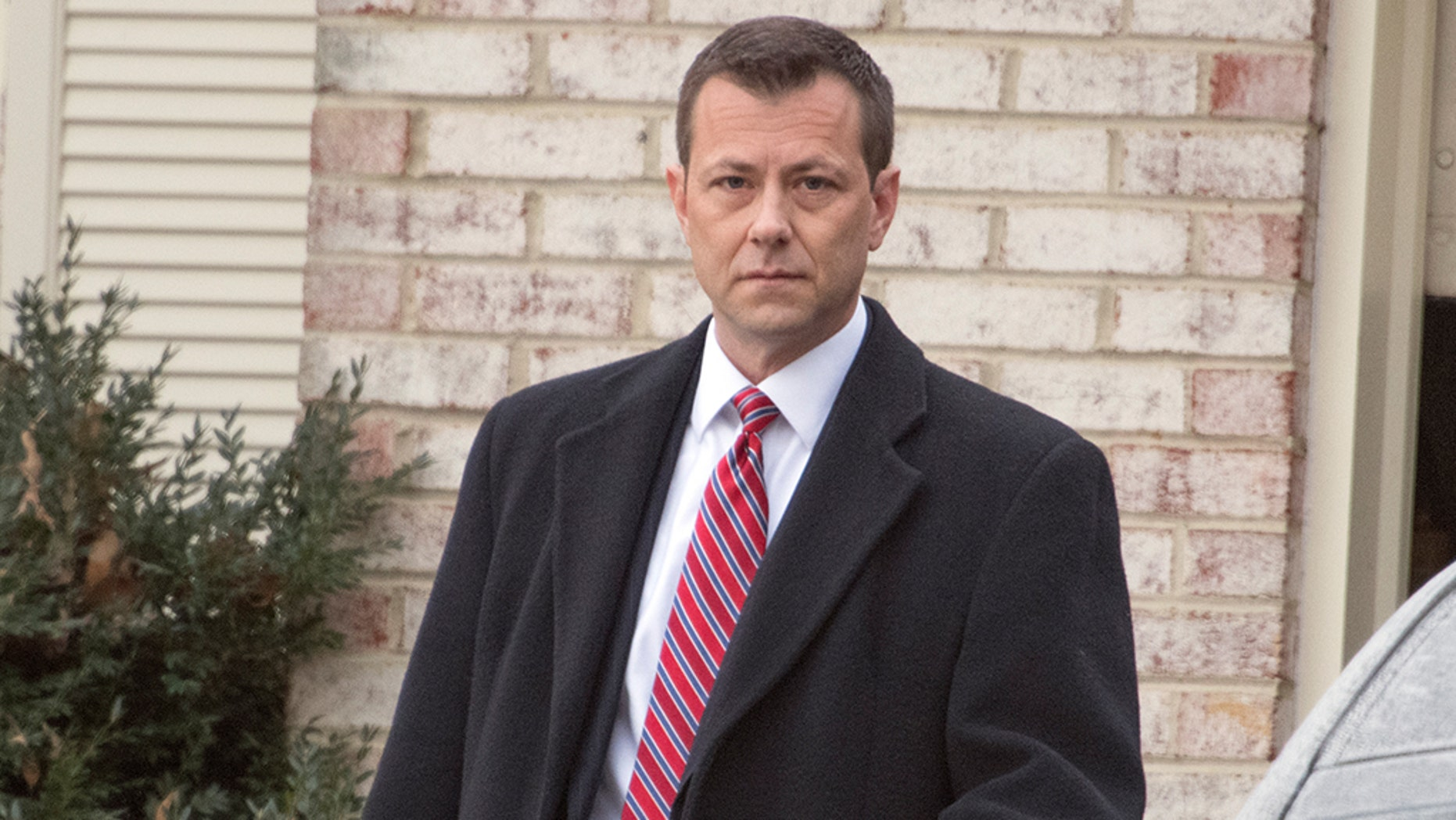 FBI Agent Peter Strzok, who exchanged 375 text messages with Department of Justice attorney Lisa Page that led to his removal from special counsel Robert Mueller's probe into ties between the Trump campaign and the Kremlin's efforts to interfere in the U.S. election last summer, photographed outside his home in Fairfax, Virginia on Wednesday, January 3, 2018. Credit: Ron Sachs / CNP (RESTRICTION: NO New York or New Jersey Newspapers or newspapers within a 75 mile radius of any part of New York, New York, including without limitation the New York Daily News, The New York Times, and Newsday.) Photo by: Ron Sachs/picture-alliance/dpa/AP Images